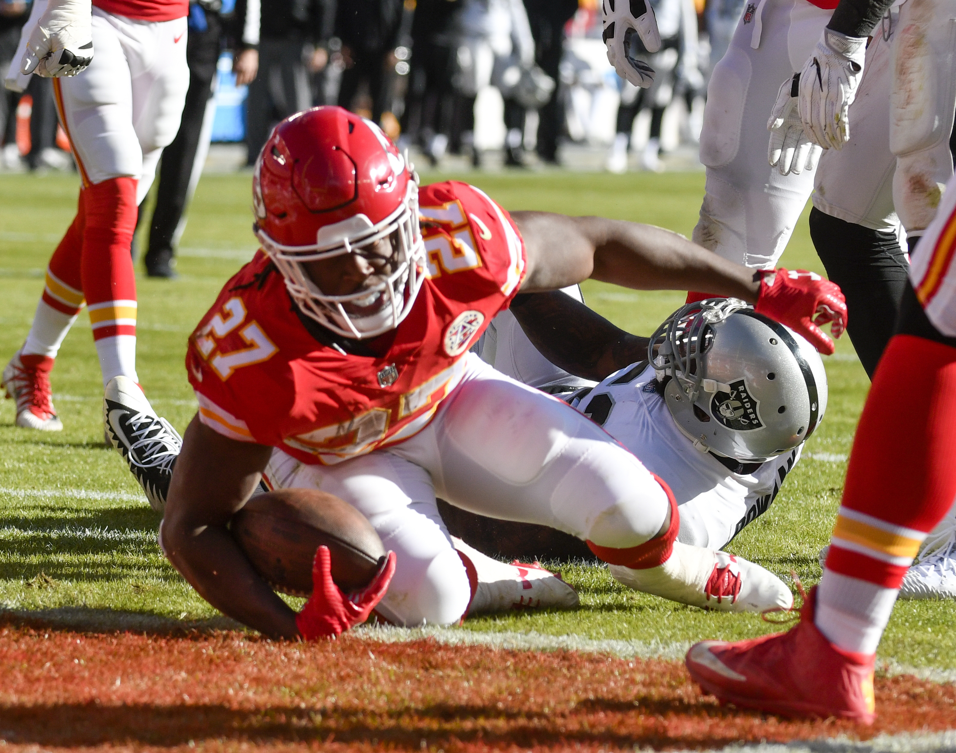 Kansas City Chiefs running back Kareem Hunt (27) scores on a one-yard run in front of Oakland Raiders linebacker NaVorro Bowman (53), during the first half of an NFL football game in Kansas City, Mo., Sunday, Dec. 10, 2017. (AP Photo/Ed Zurga)