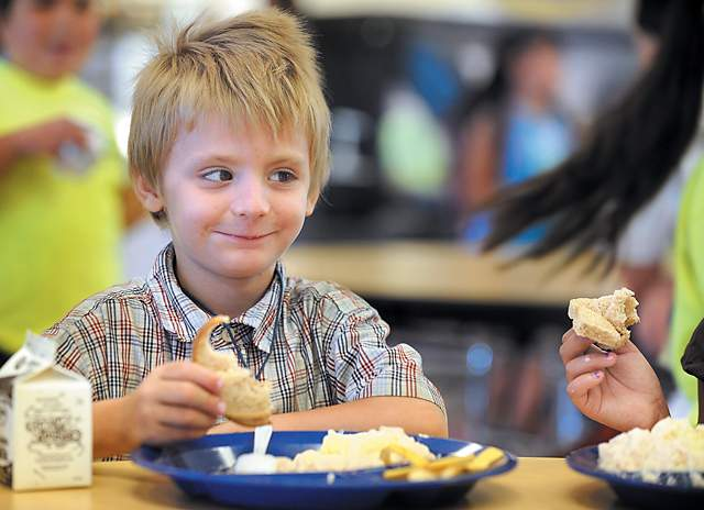 Six-year-old Elijah Ringler was one of a group from Kids Unlimited eating lunch Wednesday at Jackson Elementary School, thanks to the Summer Food Service Program. About 60 percent of Jackson County children are eligible for free or reduced-price meals year-round. - Bob Pennell