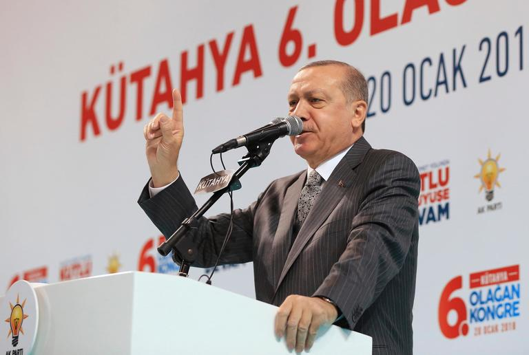 "Turkey's President Recep Tayyip Erdogan addresses his supporters in Kutahya, western Turkey, Saturday, Jan. 20, 2018. Erdogan repeated that a Turkish offensive against the Syrian Kurdish-controlled enclave of Afrin was ""de facto"" underway and said it would be followed by an operation against another Kurdish-held territory.(Kayhan Ozer/Pool Photo via AP)"