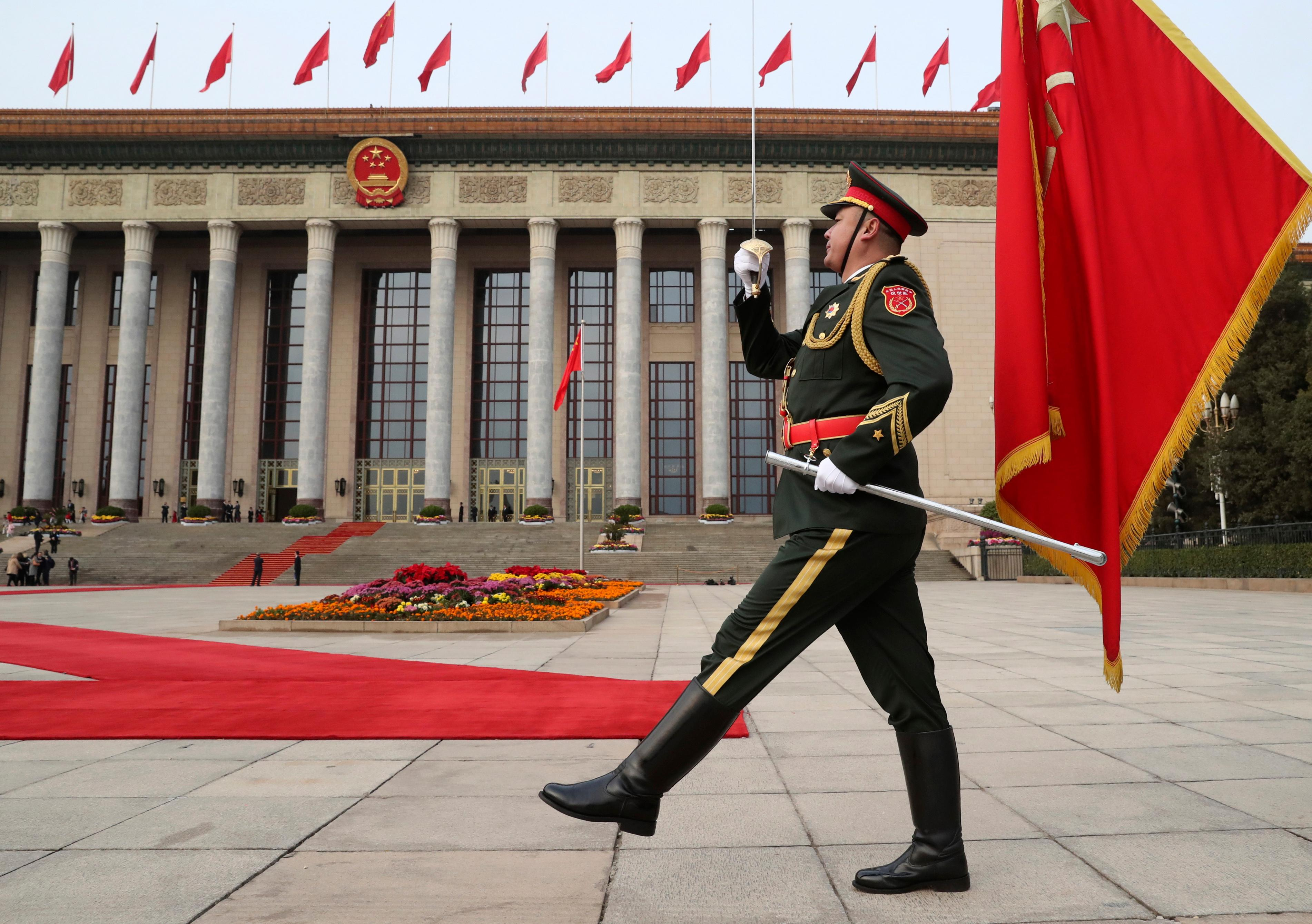 FILE - In this Nov. 9, 2017, file photo, a member of the Chinese military marches before the welcoming ceremony for President Donald Trump and Chinese President Xi Jinping at the Great Hall of the People, in Beijing, China. (AP Photo/Andrew Harnik, File)