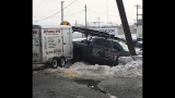 Pickup truck crashes into power pole, causes power outage in the area