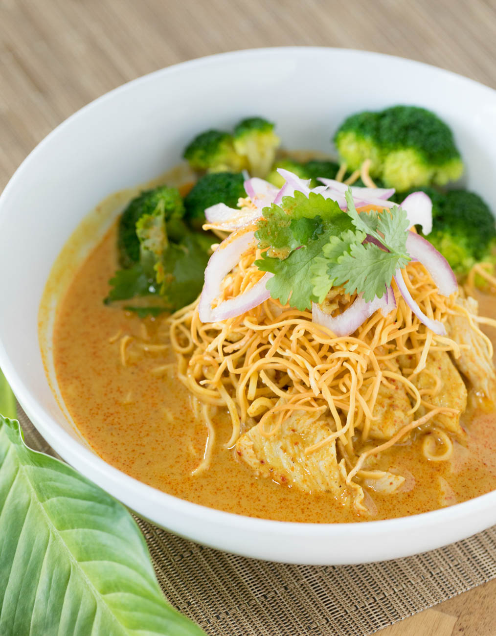 A Thai Street food special, Khao Soi Gai, is prepared with egg noodle, chicken, and curry made in-house with crispy noodles on top. / Image: Marlene Rounds // Published: 1.17.19