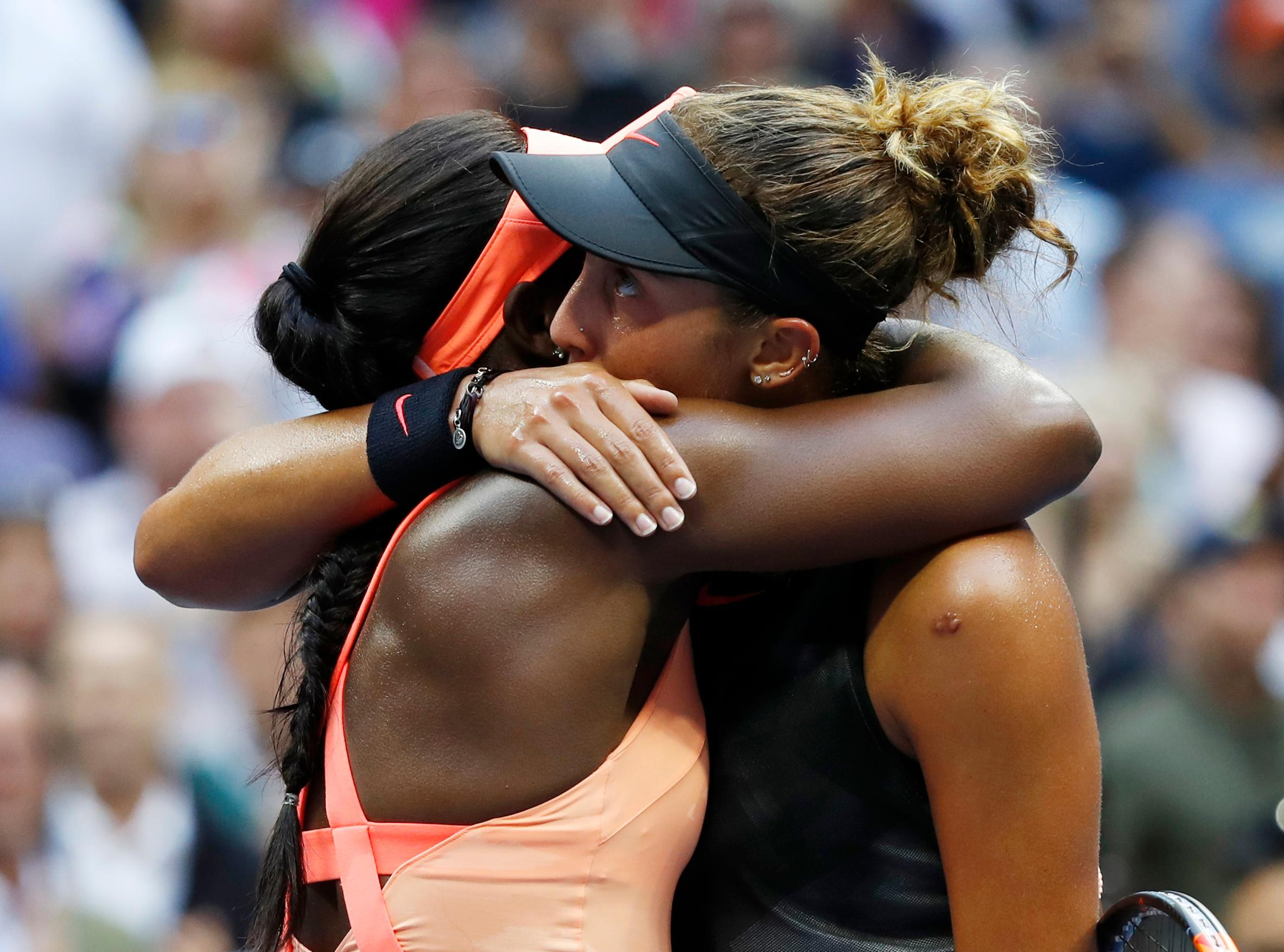Sloane Stephens, of the United States, left, hugs Madison Keys, of the United States, after winning the women's singles final of the U.S. Open tennis tournament, Saturday, Sept. 9, 2017, in New York. (AP Photo/Adam Hunger)