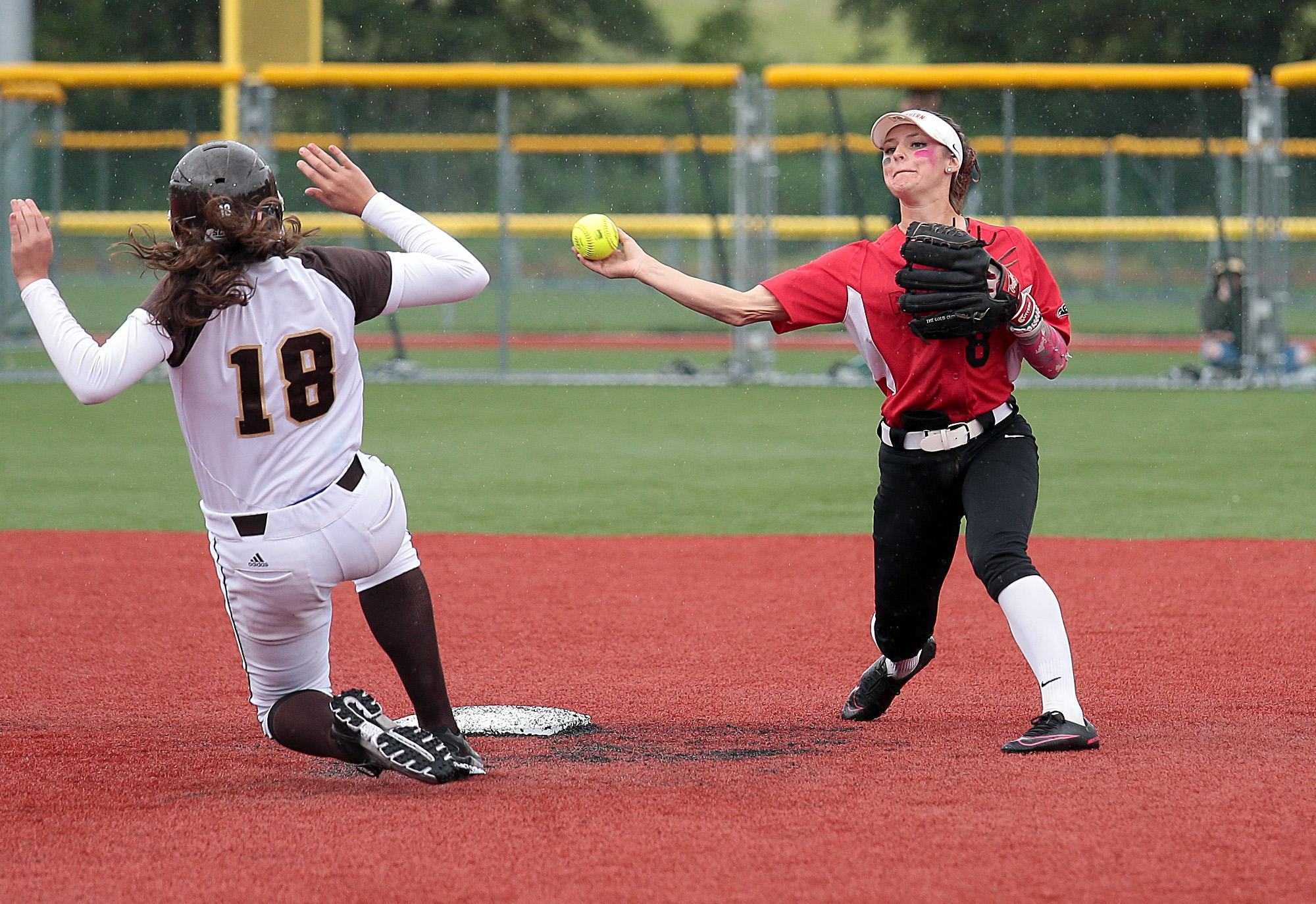 Southern Oregon University senior Kelsey Randall attempts to turn the double play over sliding St. Francis base runner Hannah Santay at US Cellular Fields on Wednesday.[PHOTO BY:  LARRY STAUTH JR]
