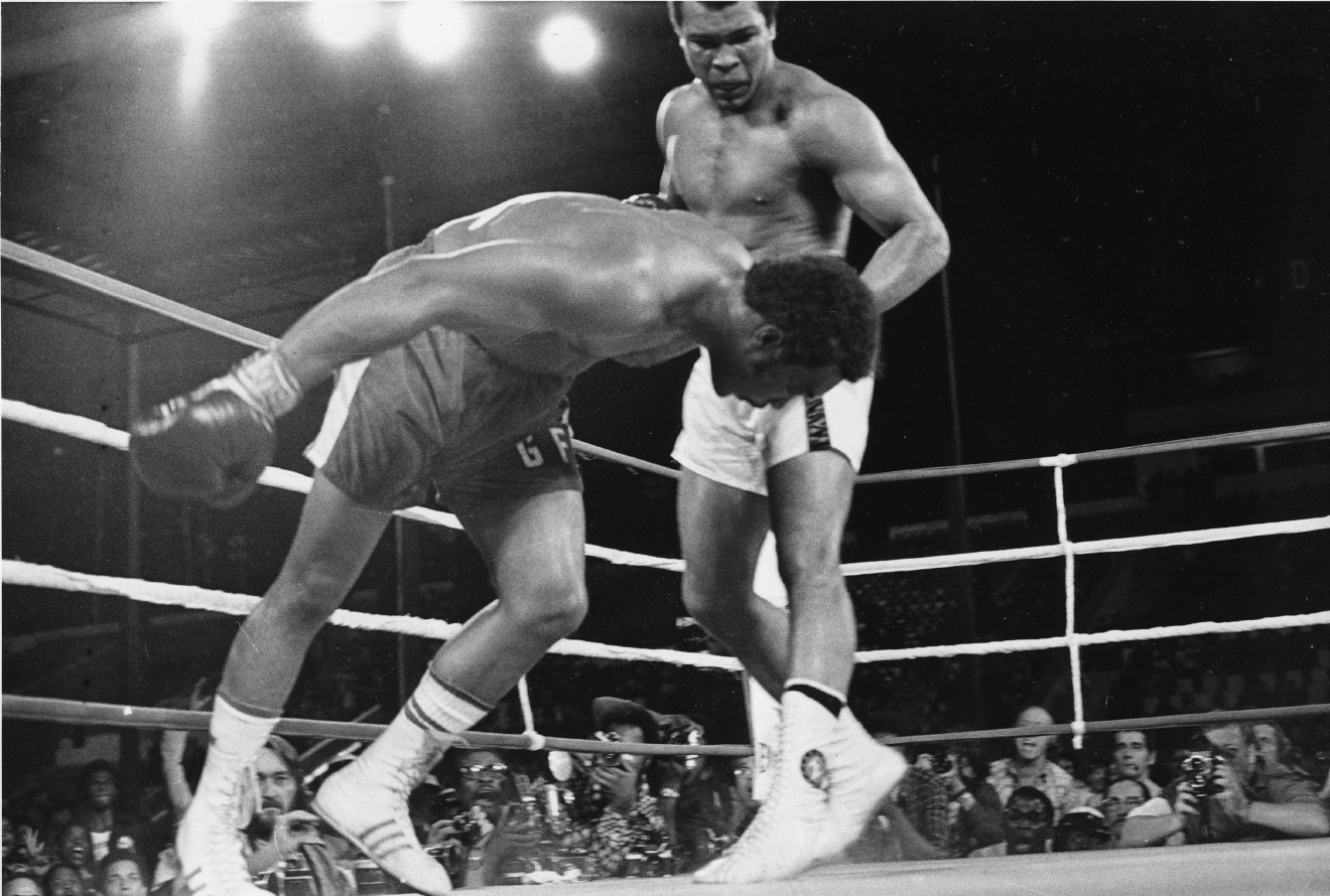 In this Oct. 30, 1974, file photo, challenger Muhammad Ali watches as defending world champion George Foreman goes down to the canvas in the eighth round of their WBA/WBC championship match in Kinshasa, Zaire. Ali, the magnificent heavyweight champion whose fast fists and irrepressible personality transcended sports and captivated the world, has died according to a statement released by his family Friday, June 3, 2016. He was 74. (AP Photo/File)