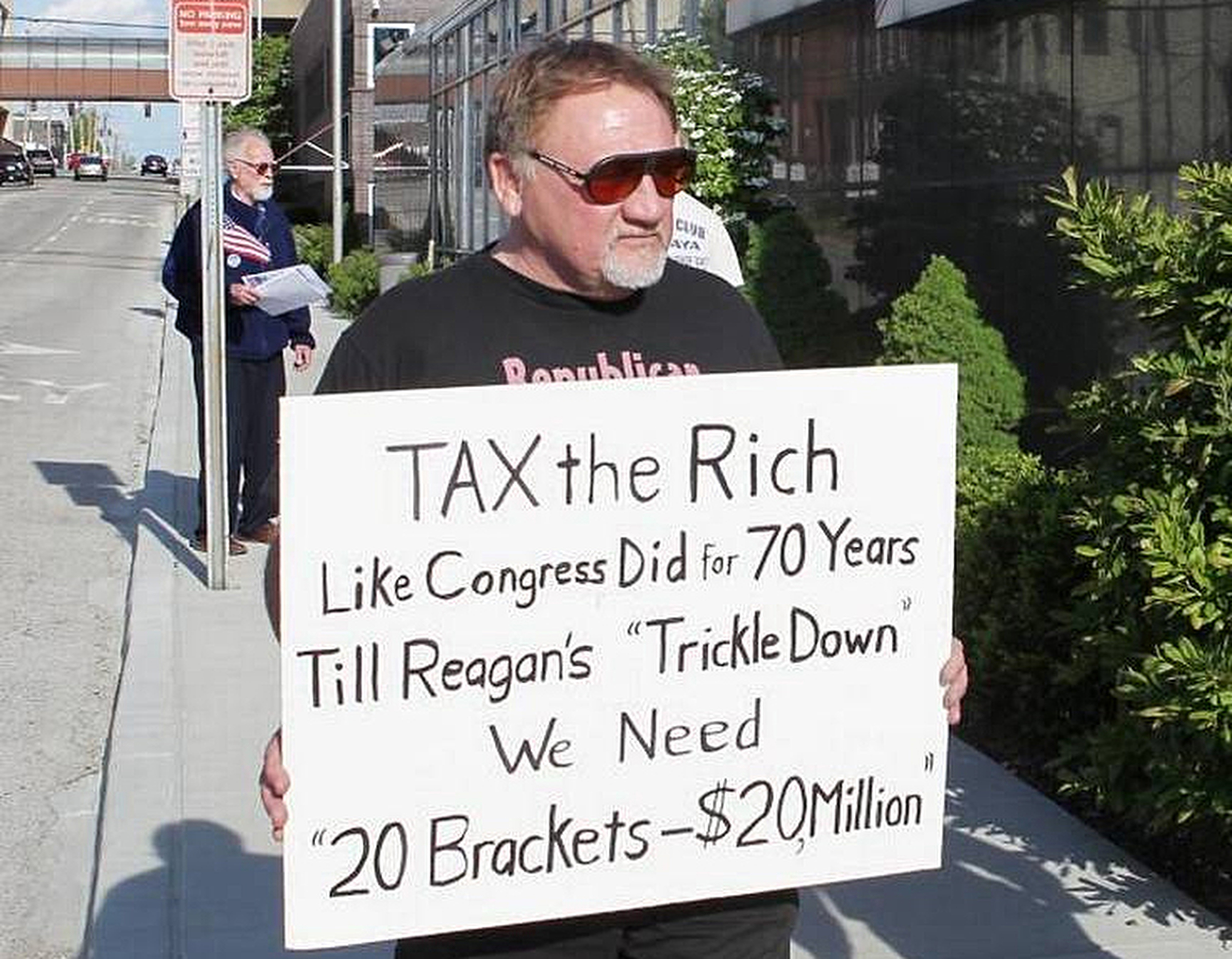 In this undated file photo, James Hodgkinson holds a sign during a protest outside of a United States Post Office in Belleville, Ill. Hodgkinson has been identified as the suspect in the Wednesday, June 14, 2017, Washington D.C. shooting. (Derik Holtmann/Belleville News-Democrat via AP)