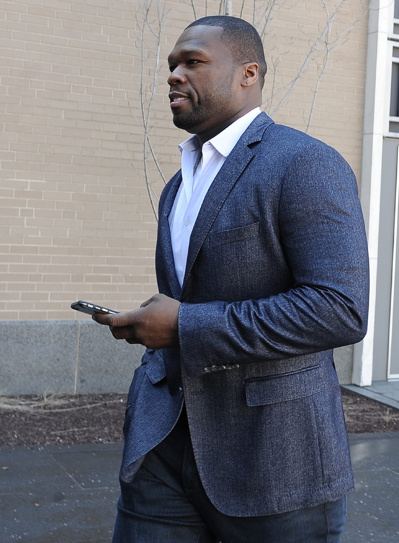 "Curtis ""50 Cent"" Jackson arrives at court for a federal bankruptcy hearing, Wednesday, March 9, 2016, in Hartford, Conn.  Jackson has been ordered to explain Instagram photos, with one depicting him next to piles of cash arranged to spell out ""broke."" Jackson filed for bankruptcy last year after a New York City jury ordered him to pay $7 million to a woman who said he posted her sex tape online. (AP Photo/Jessica Hill)"