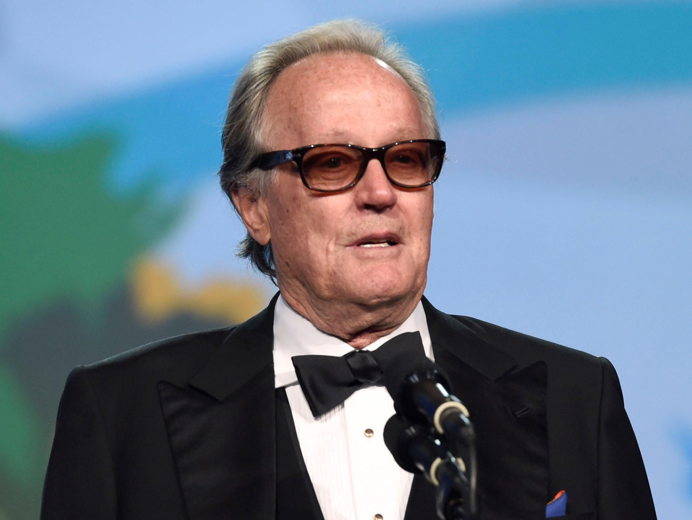 "FILE - In this Jan. 2, 2018 file photo, Peter Fonda presents the Desert Palm achievement award at the 29th annual Palm Springs International Film Festival in Palm Springs, Calif. Fonda has apologized for a late-night Twitter rant that said 12-year-old Barron Trump should be ripped from ""his mother's arms and put in a cage with pedophiles."" The all-capitals tweet early Wednesday went on to call President Donald Trump an expletive. Fonda later deleted the tweet and drew sharp rebukes from first lady Melania Trump and Donald Trump Jr. (Photo by Chris Pizzello/Invision/AP, File)"