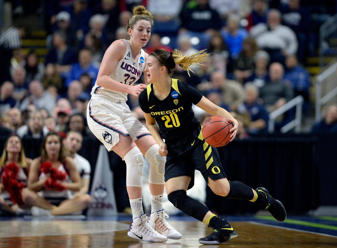 Oregon's Sabrina Ionescu drives against Connecticut's Katie Lou Samuelson during the first half of a regional final game in the NCAA women's college basketball tournament, Monday, March 27, 2017, in Bridgeport, Conn. (AP Photo/Jessica Hill)