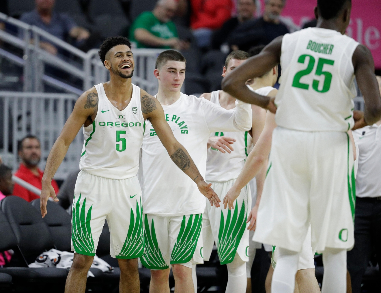 Oregon's Tyler Dorsey (5) celebrates with teammates after defeating Arizona State in an NCAA college basketball game in the quarterfinals of the Pac-12 men's tournament Thursday, March 9, 2017, in Las Vegas. Oregon won 80-57. (AP Photo/John Locher)
