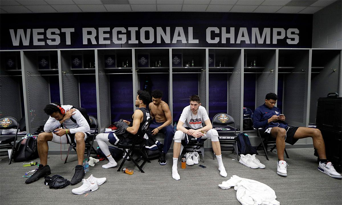 Gonzaga players sit in the locker room after the finals of the Final Four NCAA college basketball tournament against North Carolina, Monday, April 3, 2017, in Glendale, Ariz. North Carolina won 71-65. (AP Photo/Mark Humphrey)