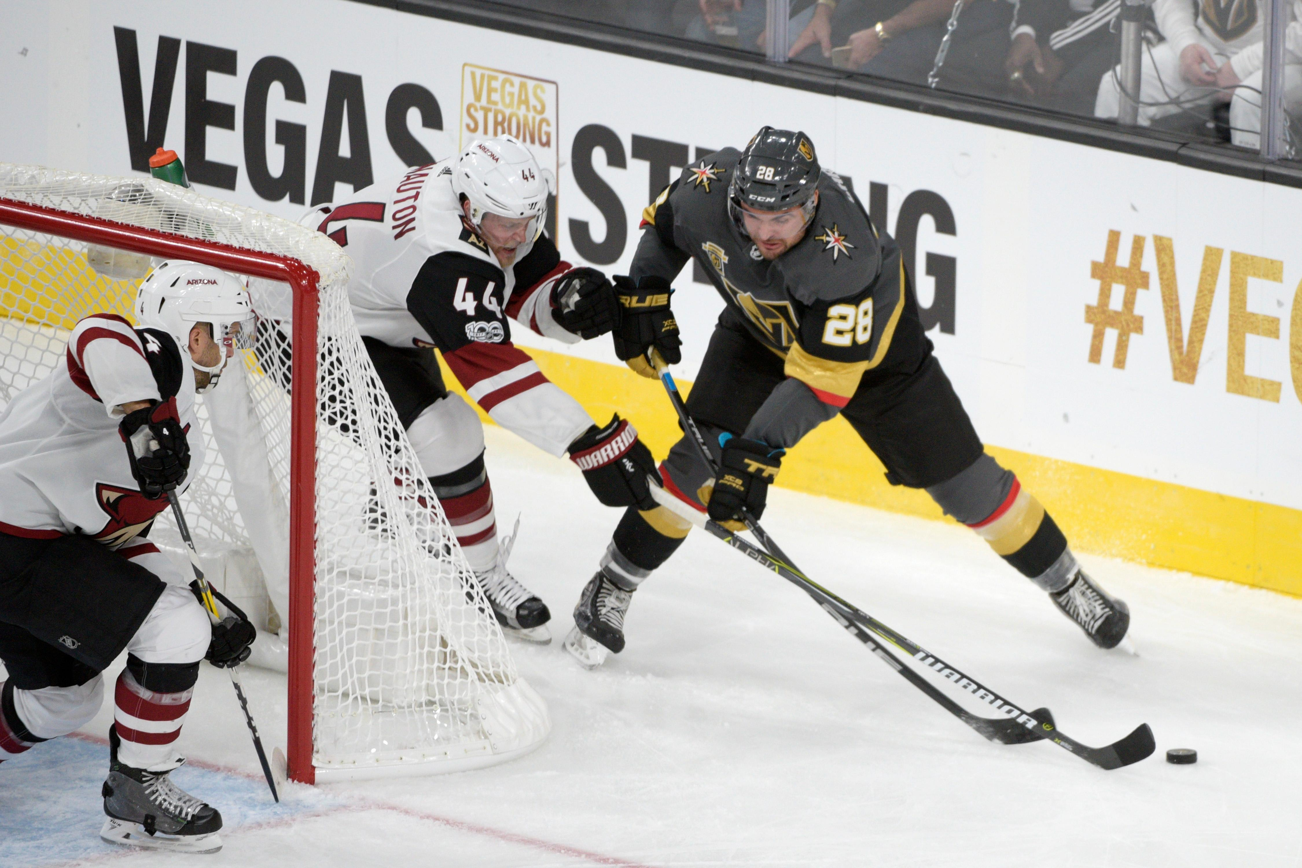 Arizona Coyotes defenseman Kevin Connauton (44) tries to keep the puck away from Vegas Golden Knights right wing William Carrier (28) during the Knights home opener Tuesday, Oct. 10, 2017, at the T-Mobile Arena. The Knights won 5-2 to extend their winning streak to 3-0. CREDIT: Sam Morris/Las Vegas News Bureau