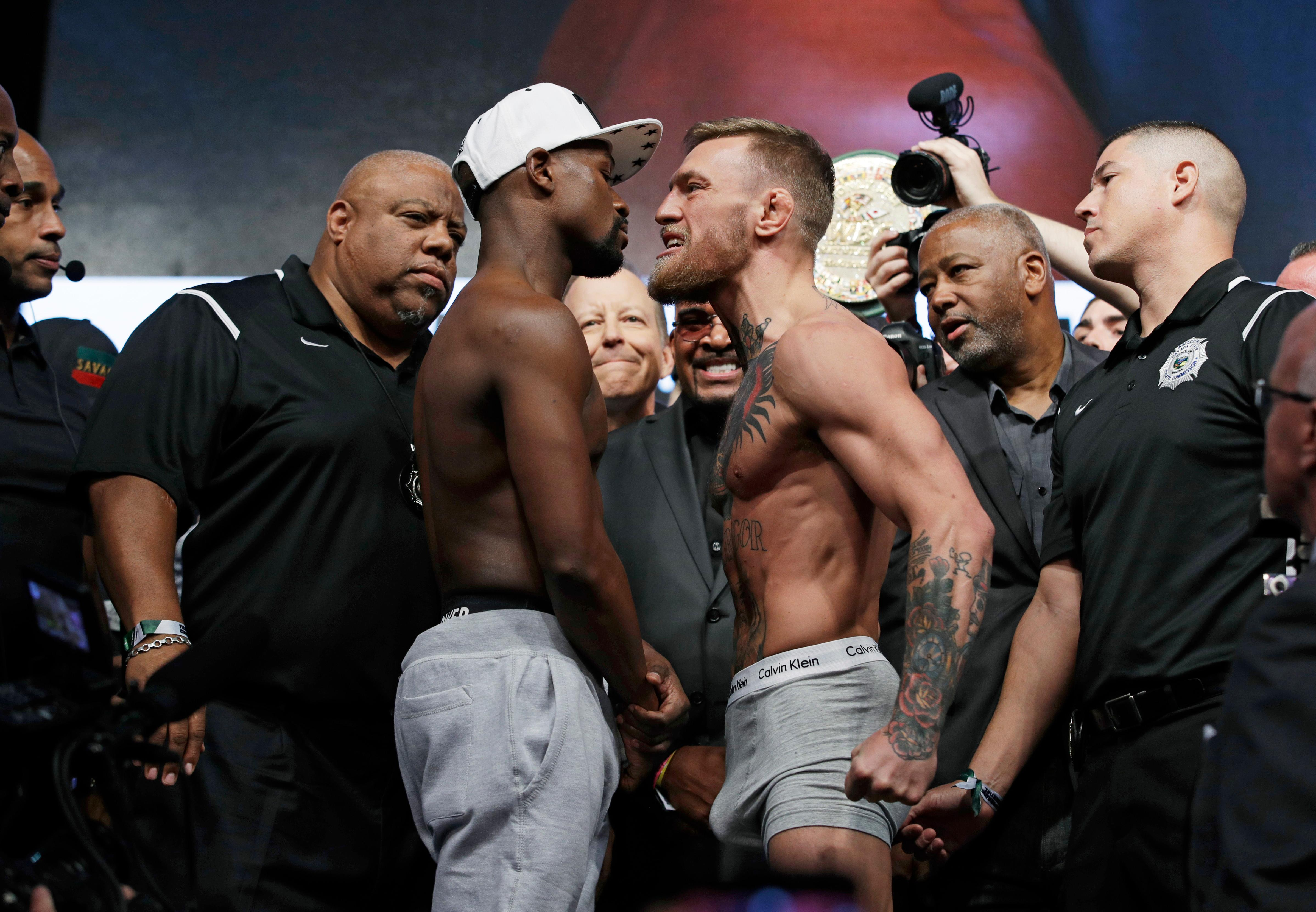Floyd Mayweather Jr., left, and Conor McGregor face off during weigh-ins Friday, Aug. 25, 2017, in Las Vegas for their Saturday boxing bout. (AP Photo/John Locher)