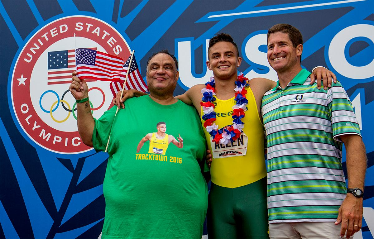Oregon's Devon Allen poses with his father Louis and coach, Jamie Cook, after winning the 110 meter hurdles in 13.03. Photo by August Frank, Oregon News Lab