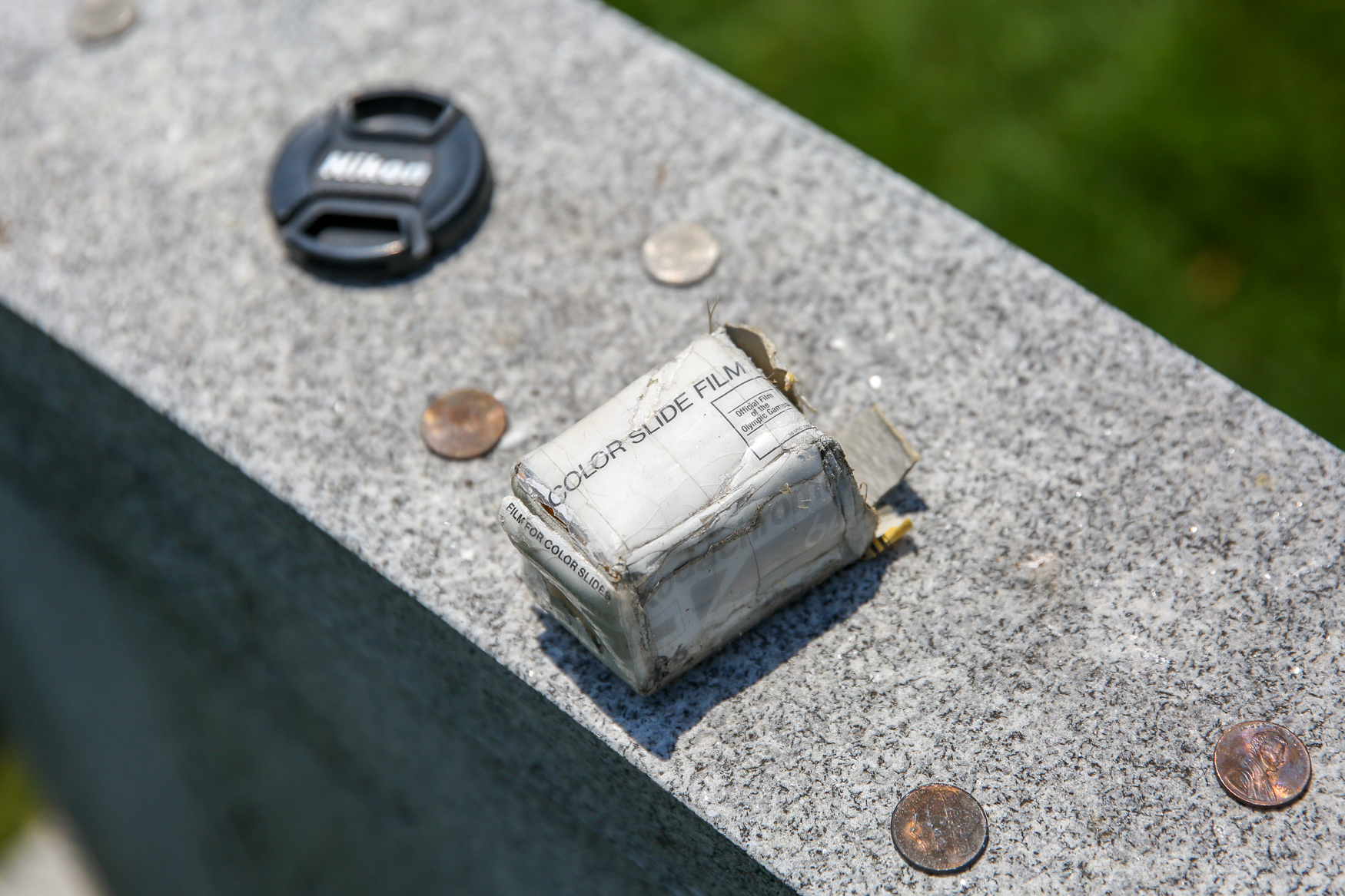 Photography accessories left by visitors at Brady's gravesite. (Amanda Andrade-Rhoades/DC Refined)<p></p>