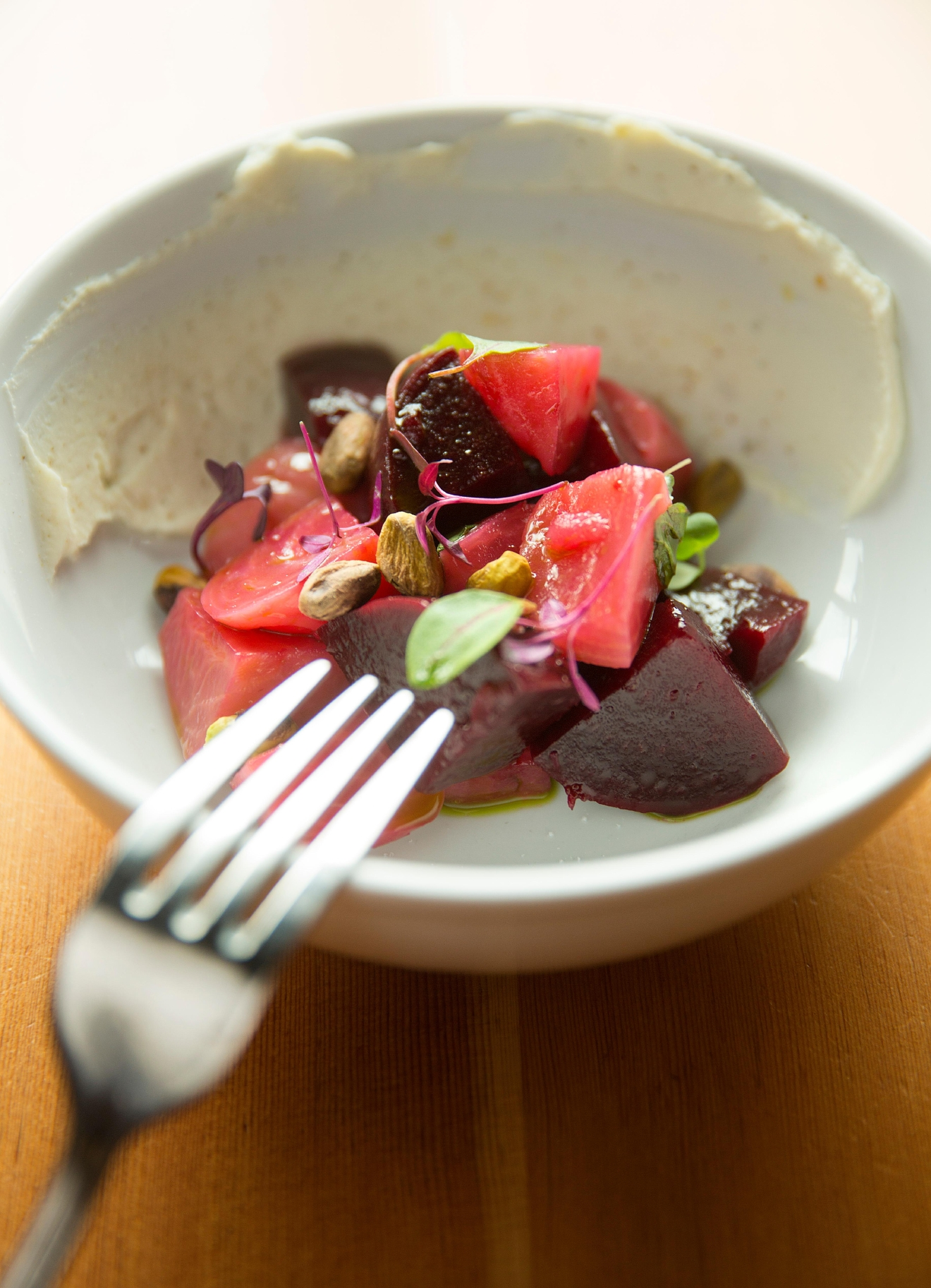 Beets with ricotta, pistachio, sherry vinegar, and basil, at Tavoláta Capitol Hill. (Sy Bean / Seattle Refined)