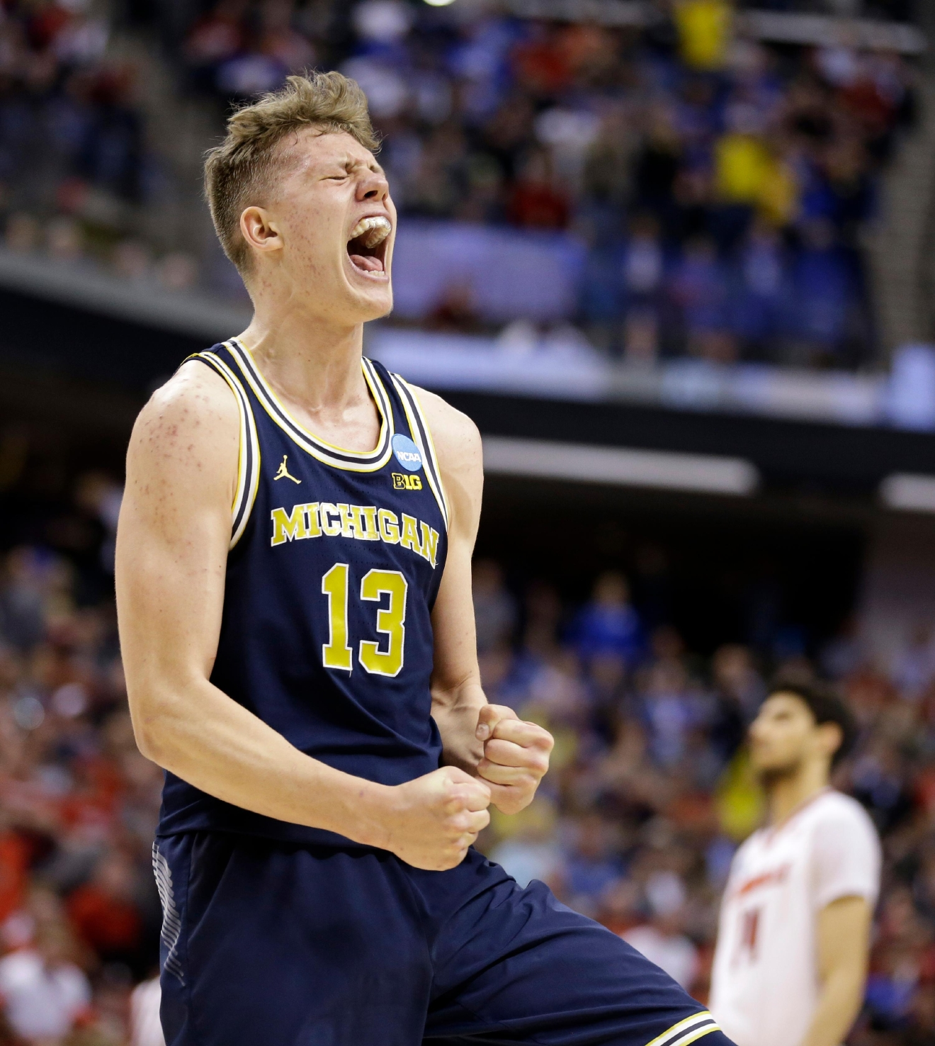 Michigan forward Moritz Wagner (13) celebrates a 73-69 win over Louisville in a second-round game in the men?s NCAA college basketball tournament in Indianapolis, Sunday, March 19, 2017. (AP Photo/Michael Conroy)