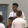 Former hoops star Tucker gives back to Sun City