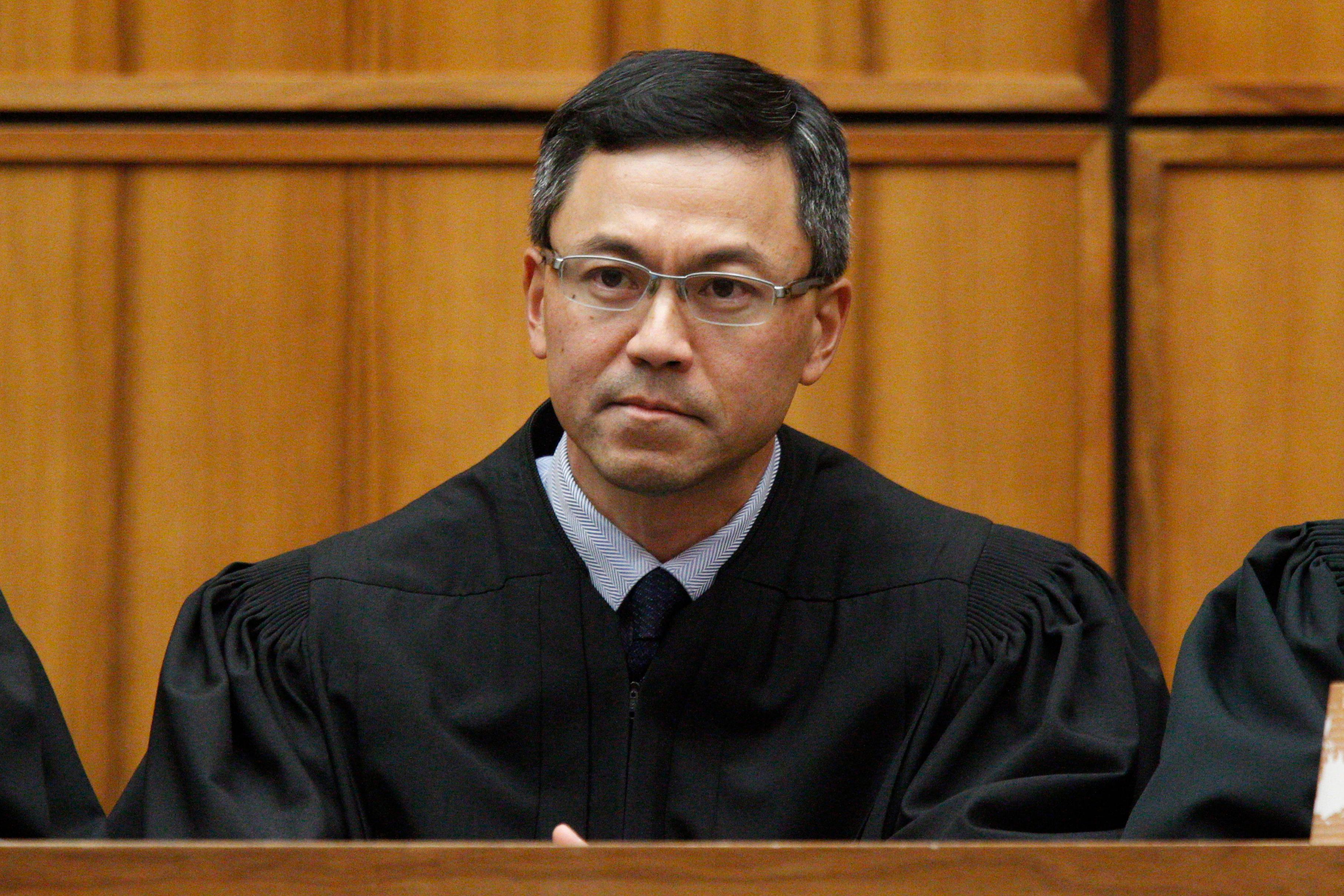 "FILE - This Dec. 2015 file photo shows U.S. District Judge Derrick Watson in Honolulu. Hawaii's Democratic lawmakers on Thursday, April 20, 2017, criticized Attorney General Jeff Sessions after he expressed amazement on a radio show that a ""judge sitting on an island in the Pacific"" could stop the president's travel ban. Watson last month blocked President Donald Trump's executive order prohibiting new visas for people from six Muslim-majority countries and temporarily halting the U.S. refugee program. The Trump Administration appealed the ruling. (George Lee/The Star-Advertiser via AP, File)"