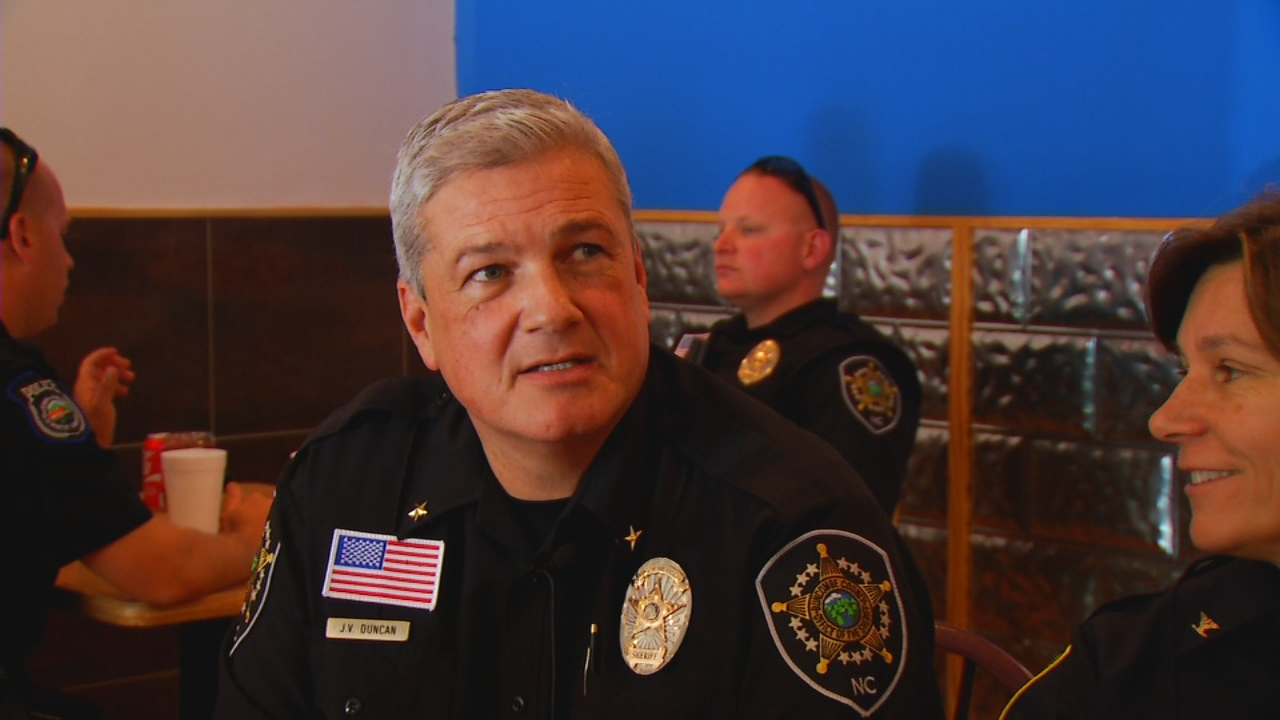 Prominent law enforcement leaders were among those supporting a fundraiser Thursday for Woodfin Police Chief Brett Holloman. (Photo credit: WLOS staff)