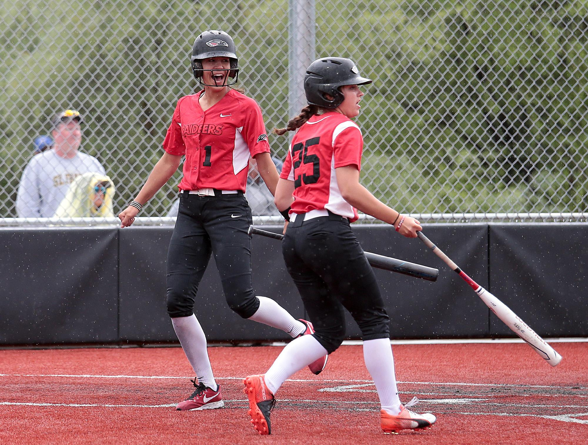 Larry Stauth Jr./For the Daily TidingsSouthern Oregon University freshman first baseman Tayler Walker, left, reacts after scoring against St. Francis at U.S. Cellular Community Park on Wednesday.