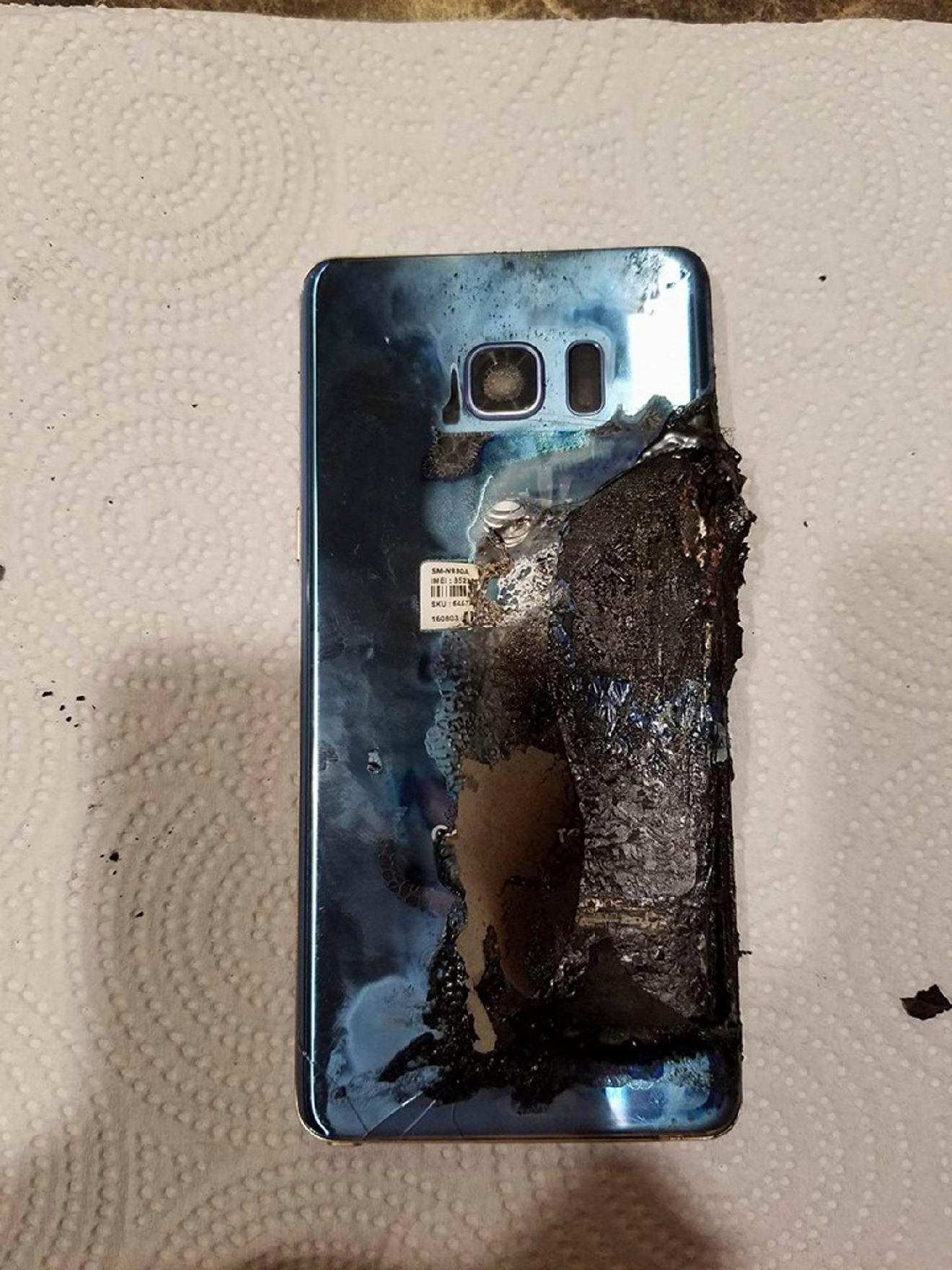 This Sept. 8, 2016, photo, shows a damaged Samsung Galaxy Note 7, in Marion, Ill., belonging to Joni Gantz Barwick, who was woken up at 3 a.m. by smoke and sparks from her Galaxy Note 7. (Joni Gantz Barwick via AP)