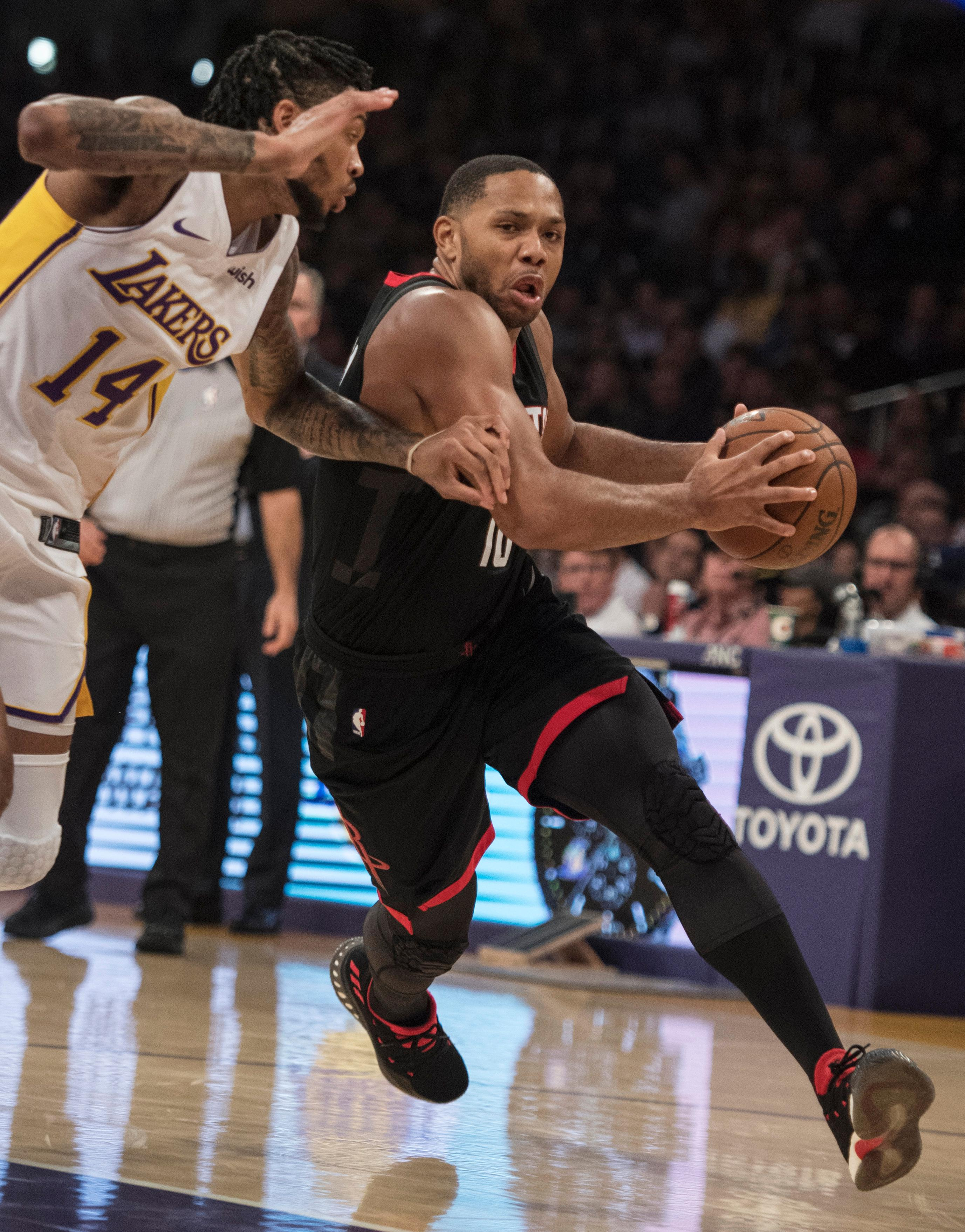Houston Rockets guard Eric Gordon drives past Los Angeles Lakers forward Brandon Ingram (14) during the first half of an NBA basketball game Sunday, Dec. 3, 2017, in Los Angeles. (AP Photo/Kyusung Gong)