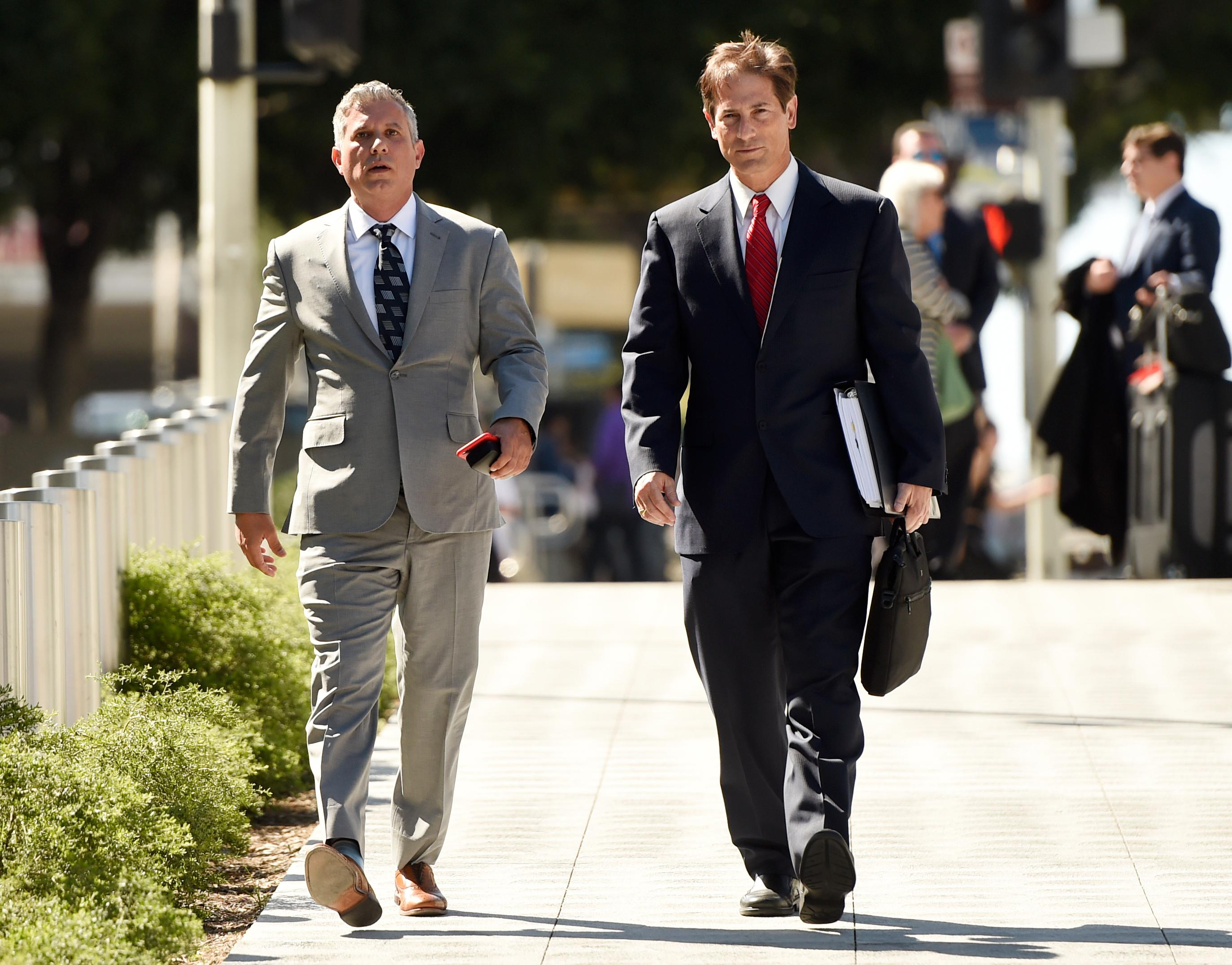 Jonathan Todd Schwartz, left, former business manager for singer Alanis Morissette, arrives with his attorney Nathan Hoffman at U.S. federal court for the sentencing in his embezzlement case, Wednesday, May 3, 2017, in Los Angeles. Schwartz pleaded guilty earlier tis year after admitting he embezzled more than $7 million from the singer and other celebrities. (AP Photo/Chris Pizzello)