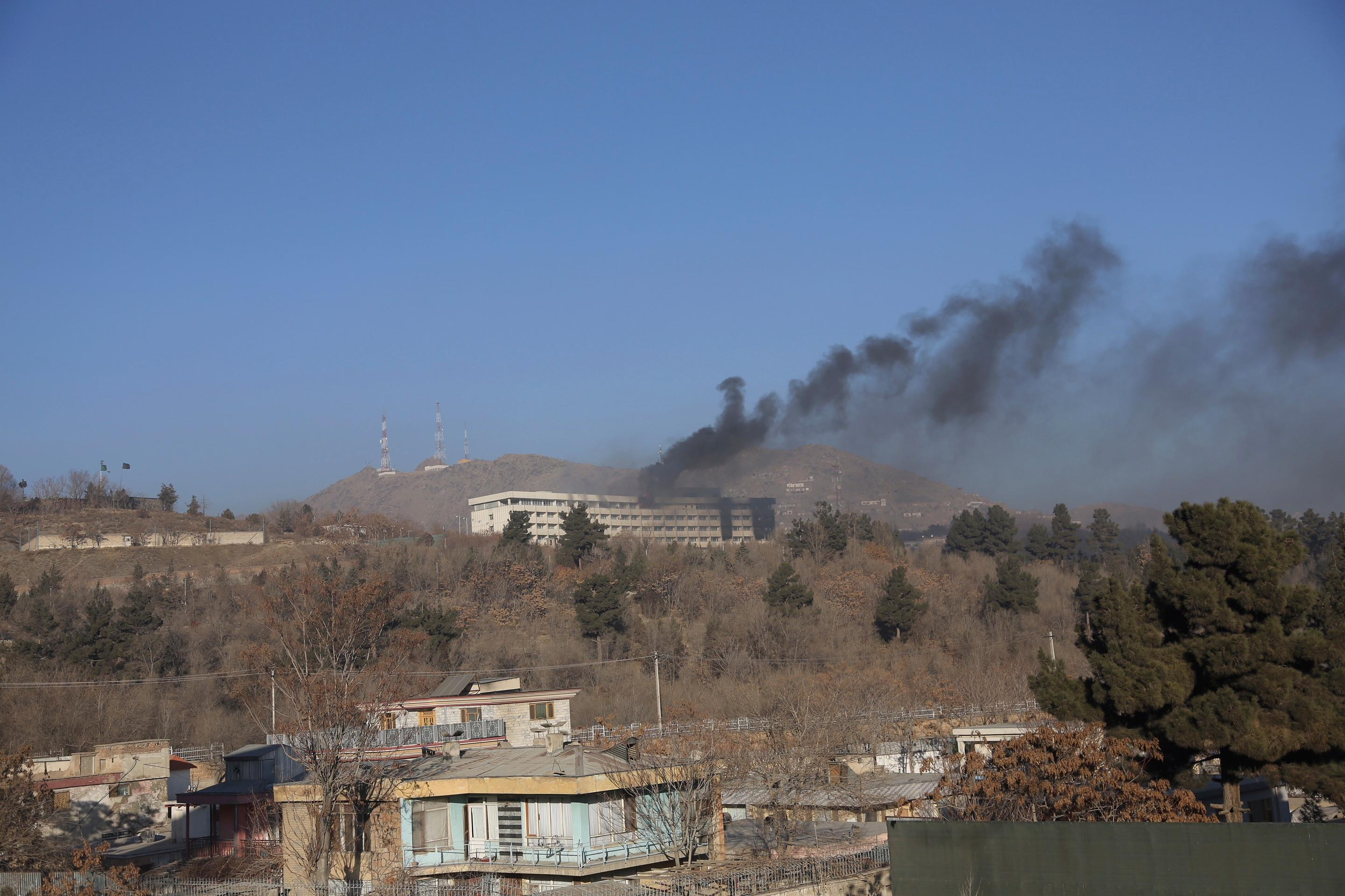 Black smoke rises from the Intercontinental Hotel after an attack in Kabul, Afghanistan, Sunday, Jan. 21, 2018. Gunmen stormed the hotel in the Afghan capital on Saturday evening, triggering a shootout with security forces, officials said. (AP Photo/Rahmat Gul)
