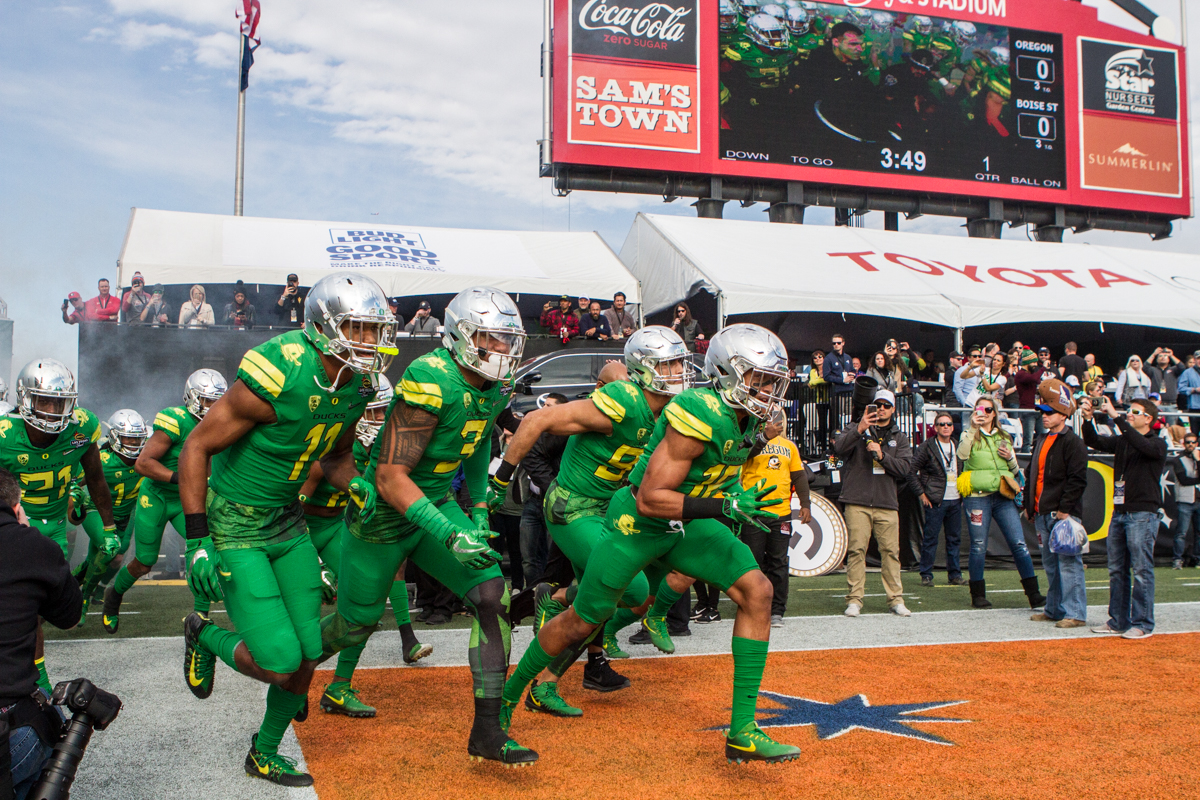 Oregon players enter Sam Boyd Stadium prior to kickoff. The Oregon Ducks trail the Boise State Broncos 14 to 24 at the end of the first half of the Las Vegas Bowl at Sam Boyd Stadium in Las Vegas, Nevada. Photo by Ben Lonergan, Oregon News Lab