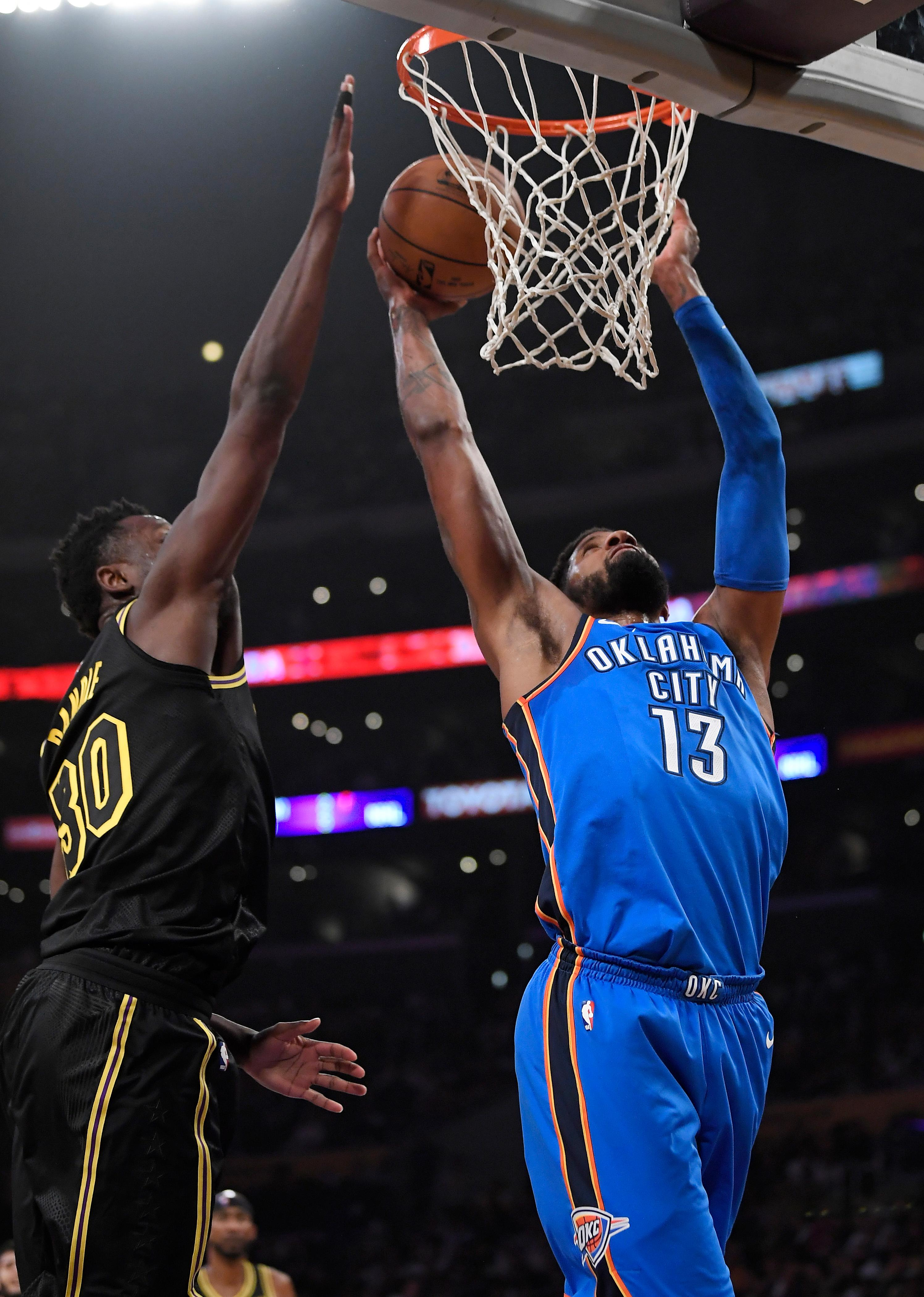 Oklahoma City Thunder forward Paul George, right, shoots as Los Angeles Lakers forward Julius Randle defends during the first half of an NBA basketball game, Thursday, Feb. 8, 2018, in Los Angeles. (AP Photo/Mark J. Terrill)