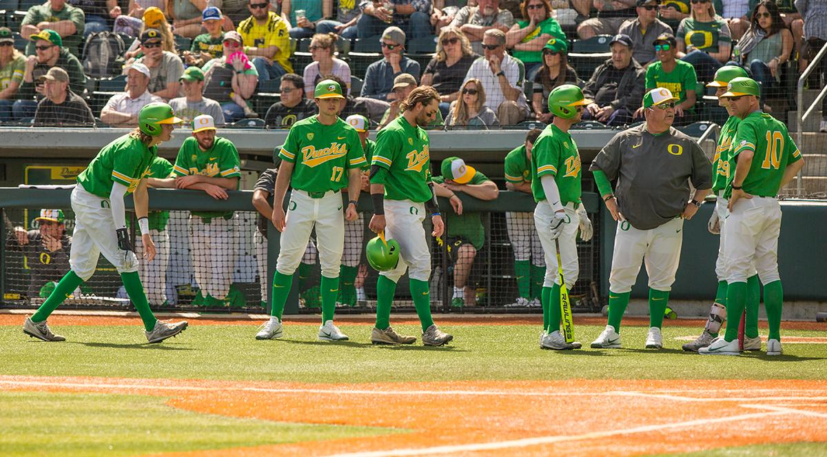 Head Coach George Horton speaks with the team as they take the infield. Despite a late comeback, the Ducks fall to Arizona State Sun Devils 4-3 in the second game of a three-game series. Photo by James Wegter, Oregon News Lab