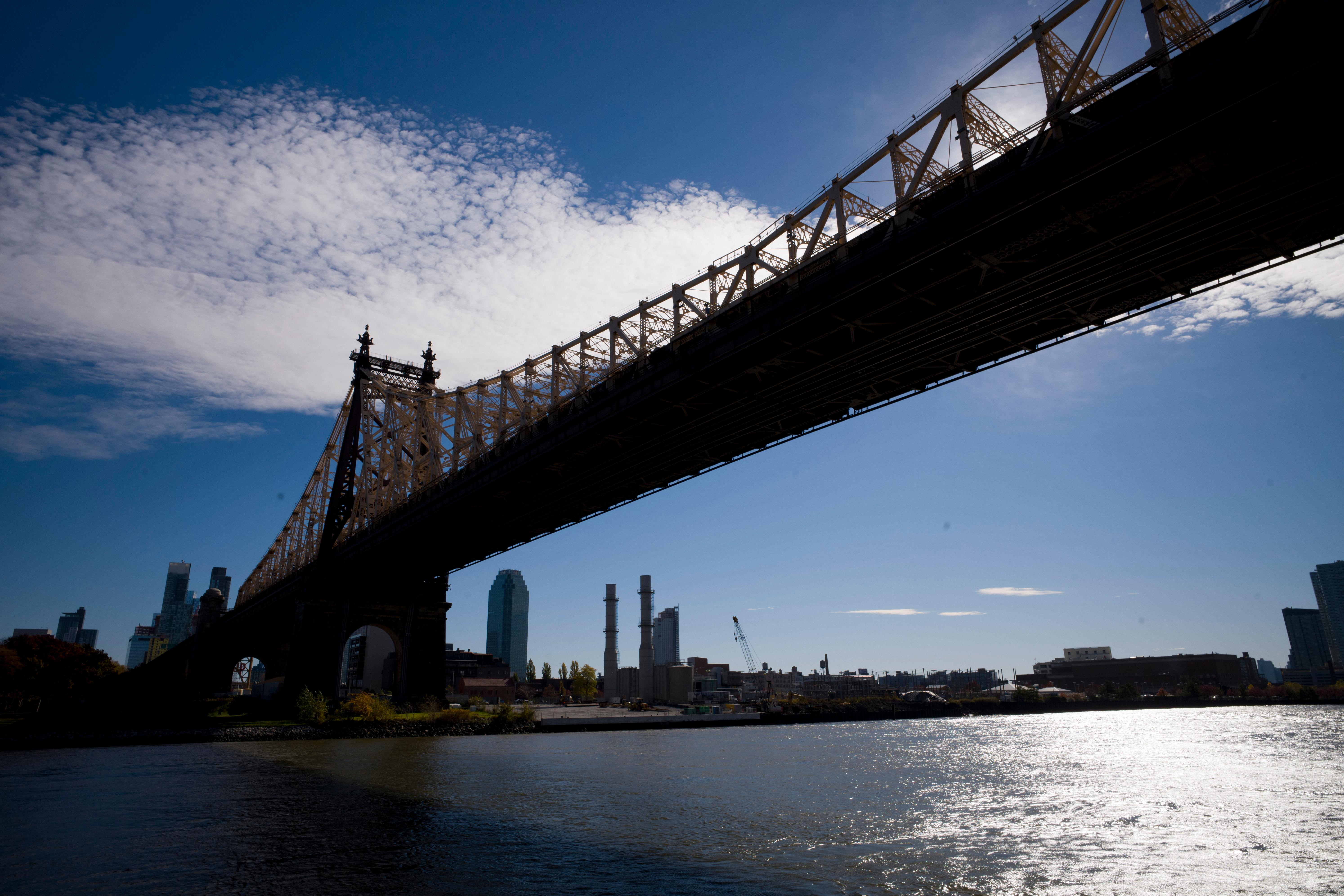 FILE- In this Wednesday, Nov. 7, 2018, file photo, the East River flows under the Ed Koch Queensboro Bridge and past the Long Island City skyline and waterfront in New York. On Tuesday, Nov. 13, Amazon said it will split its second headquarters between Long Island City in New York and Crystal City. (AP Photo/Mark Lennihan, File)