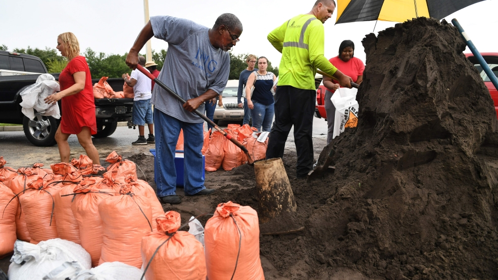 Sarasota County, Florida, residents fill sandbags with dirt Wednesday at Newtown Estates Rec Center as they prepare for Hurricane Irma. The country was provided 10 sandbags and sand or dirt for residents until they ran out of sandbags shortly after noon on Wednesday. Resident could still get dirt, but had to provide and fill their own bags. A new shipment of sandbags is expected on Thursday. [Herald-Tribune staff photo / Mike Lang]