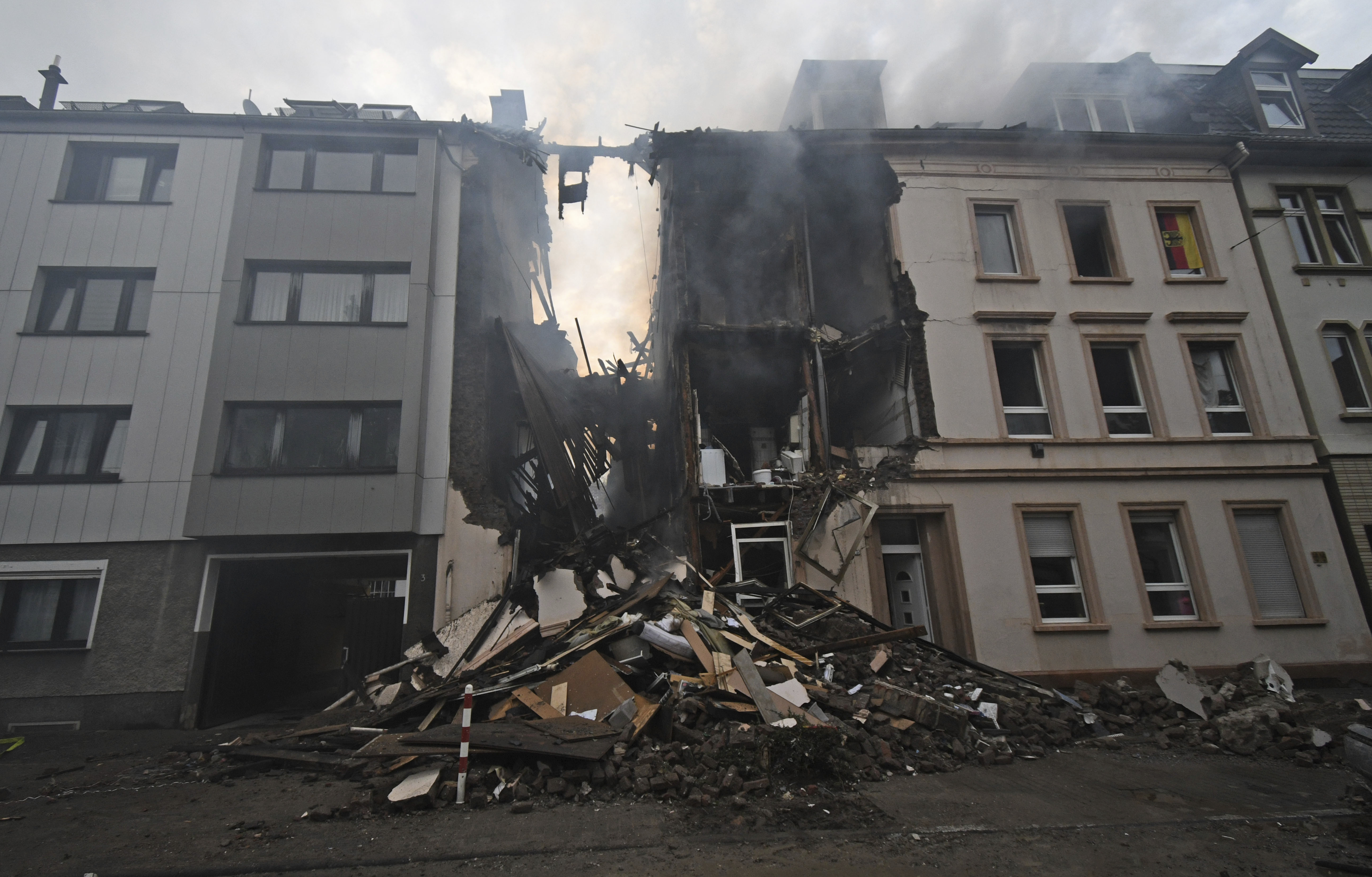 A house is destroyed after an explosion in Wuppertal, Germany, June 24, 2018. German police say 25 people were injured, when an explosion destroyed a several-store building in the western city of Wuppertal. (Henning Kaiser/dpa via AP)