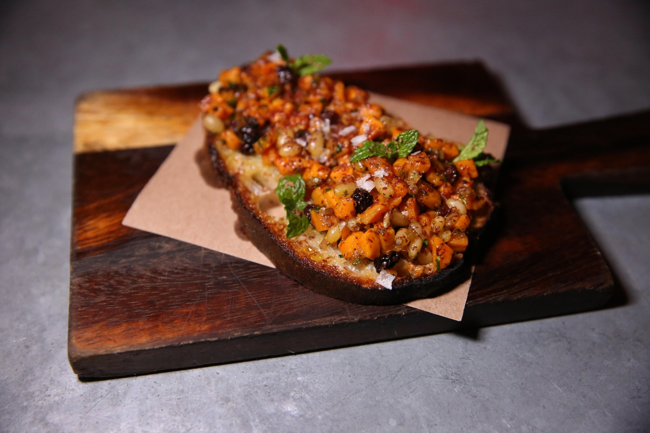 The sourdough bruschetta features a sweet potato caponata and bittersweet chocolate. At least one of those ingredients is an aphrodisiac. (Amanda Andrade-Rhoades/DC Refined)