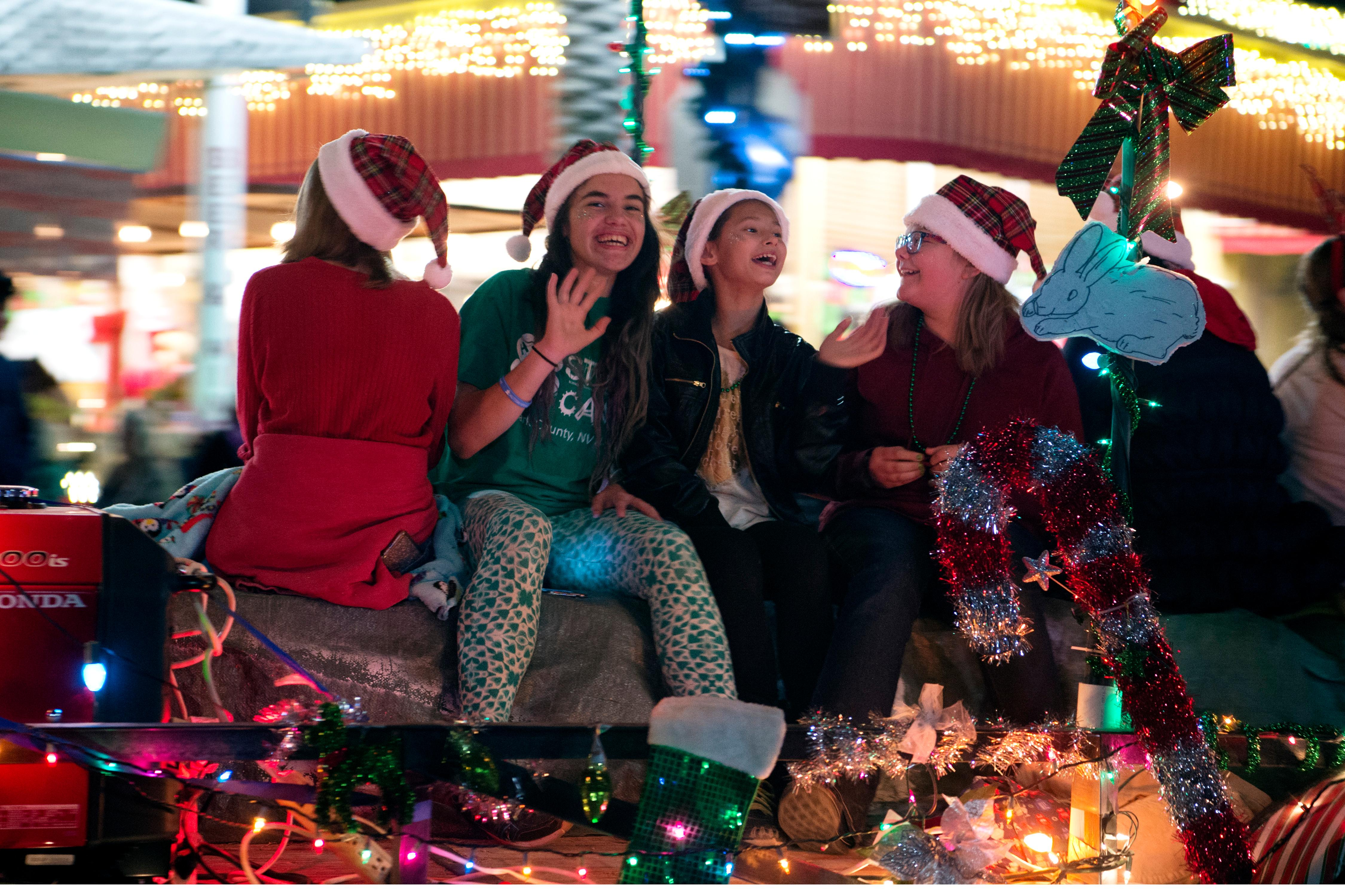Young girls on a float wave to the crowd during the Santa's Electric Parade Saturday, December 2, 2017, in Boulder City. [Sam Morris/Las Vegas News Bureau]