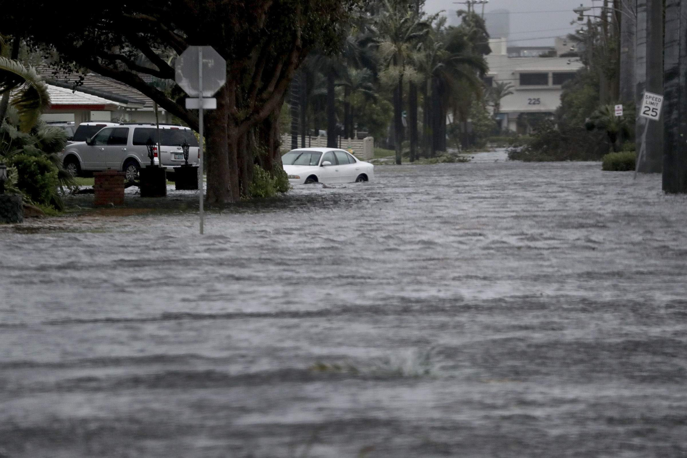 Floodwaters cover part of 3rd Ave in Dania Beach, east of U.S. Route 1, Fla., Sunday, Sept. 10, 2017, as Hurricane Irma passes. (Susan Stocker/South Florida Sun-Sentinel via AP)