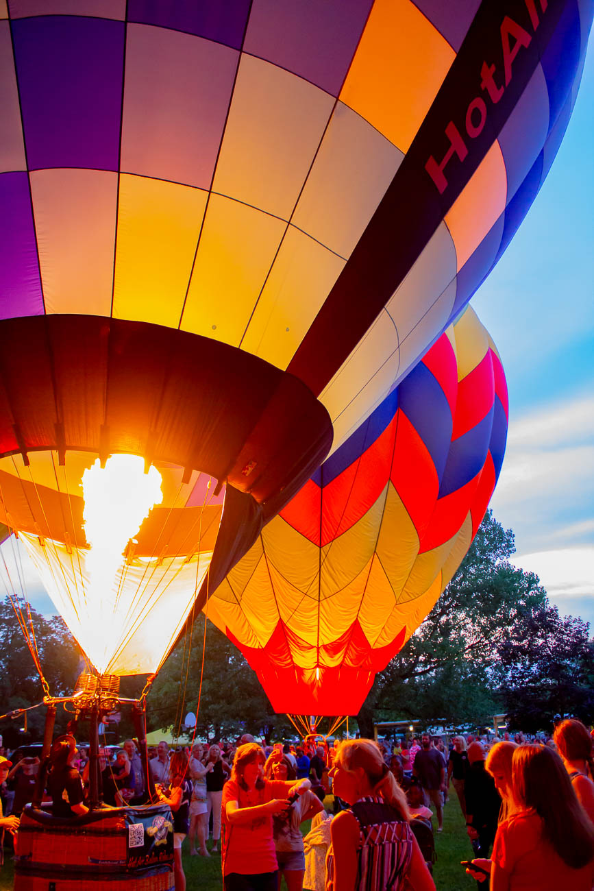 Over a dozen hot air balloons illuminated the sky as the sun set. They were organized by balloon meister Brian Trapp, who has coordinated the display every year. Visitors were able to walk around and see them up-close. / Image: Katie Robinson, Cincinnati Refined // Published: 7.4.19