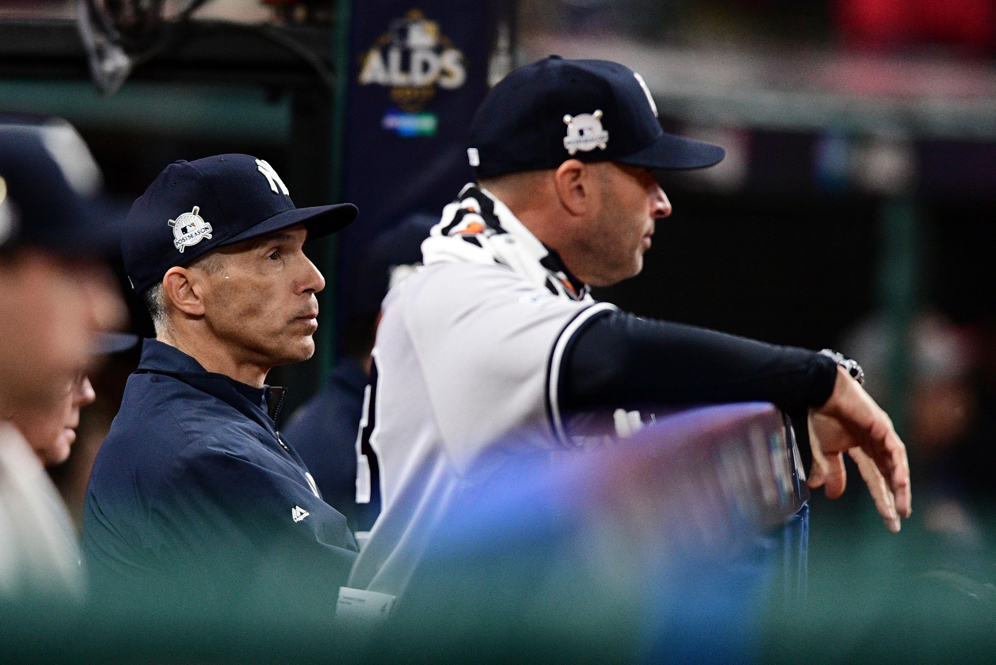 New York Yankees manager Joe Girardi watches from the dugout during the fifth inning of Game 5 of the baseball team's American League Division Series against the Cleveland Indians, Wednesday, Oct. 11, 2017, in Cleveland. (AP Photo/David Dermer)