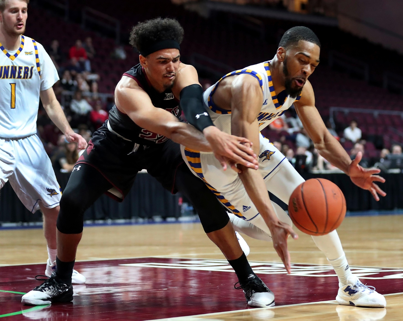 New Mexico State forward Eli Chuha, front left, reaches for a loose ball with Cal State Bakersfield forward Jaylin Airington during the second half of an NCAA college basketball game in the final of the Western Athletic Conference tournament Saturday, March 11, 2017, in Las Vegas. New Mexico State won 70-60. (AP Photo/L.E. Baskow)