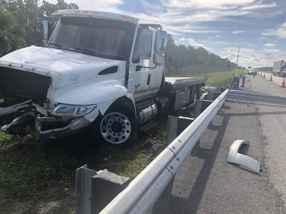 Driver crashes into FHP patrol car stopped in emergency lane