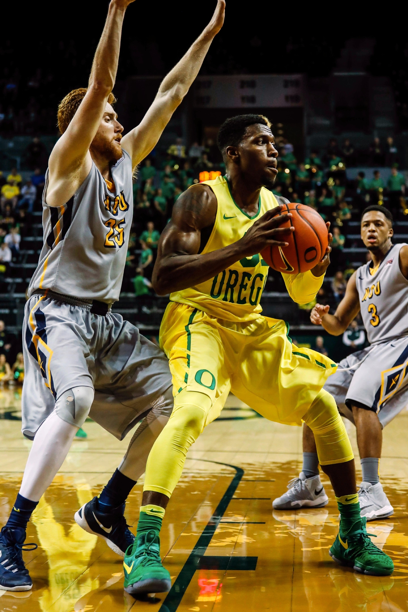 Oregon Ducks guard Dylan Ennis (31), pulls a rebound under pressure from Northwest Christian's Jack Hackman in an NCAA college basketball exhibition game in Eugene, Ore. Oregon defeated Northwest Christian University 86-51. (AP Photo/Thomas Boyd)