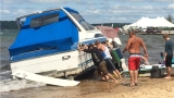 Boats damaged after being washed ashore at Grand Traverse Bay