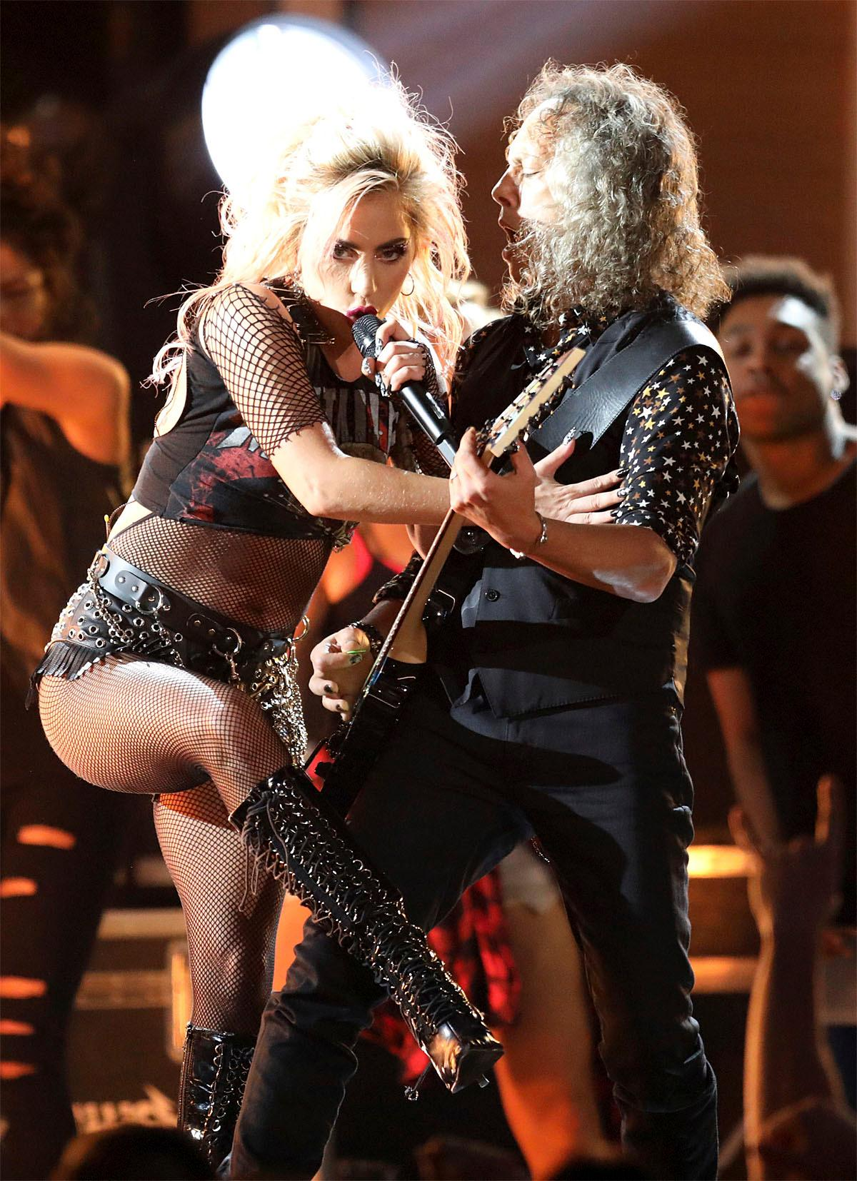 "Lady Gaga, left, and Kirk Hammett of ""Metallica"" perform ""Moth Into Flame"" at the 59th annual Grammy Awards on Sunday, Feb. 12, 2017, in Los Angeles. (Photo by Matt Sayles/Invision/AP)"