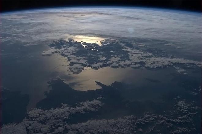 Ireland, Wales and Mann silhouetted in the setting sun. (Photo & Caption: Col. Chris Hadfield, NASA)