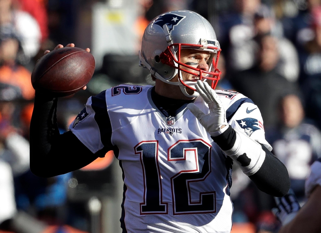New England Patriots quarterback Tom Brady passes against the Denver Broncos during the first half of an NFL football game Sunday, Dec. 18, 2016, in Denver. (AP Photo/Jack Dempsey)