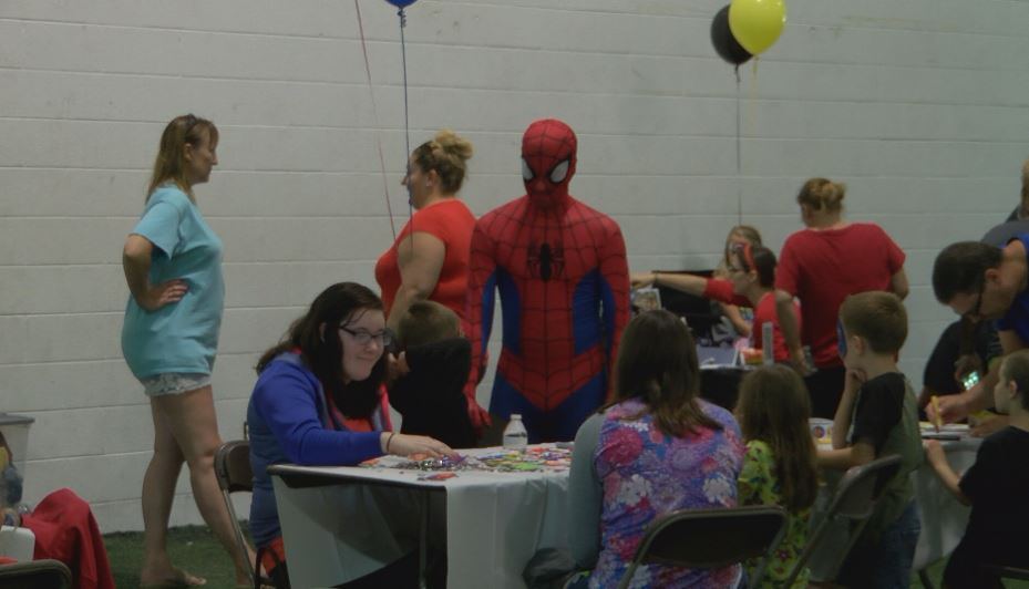 Dozens of children with autism learned how to be a superhero during an event at the Saginaw Athletic Club on Saturday morning. (Photo Credit: Drew Moore/WEYI)