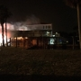Orange Beach Fire Department responding to a multi-story house fire