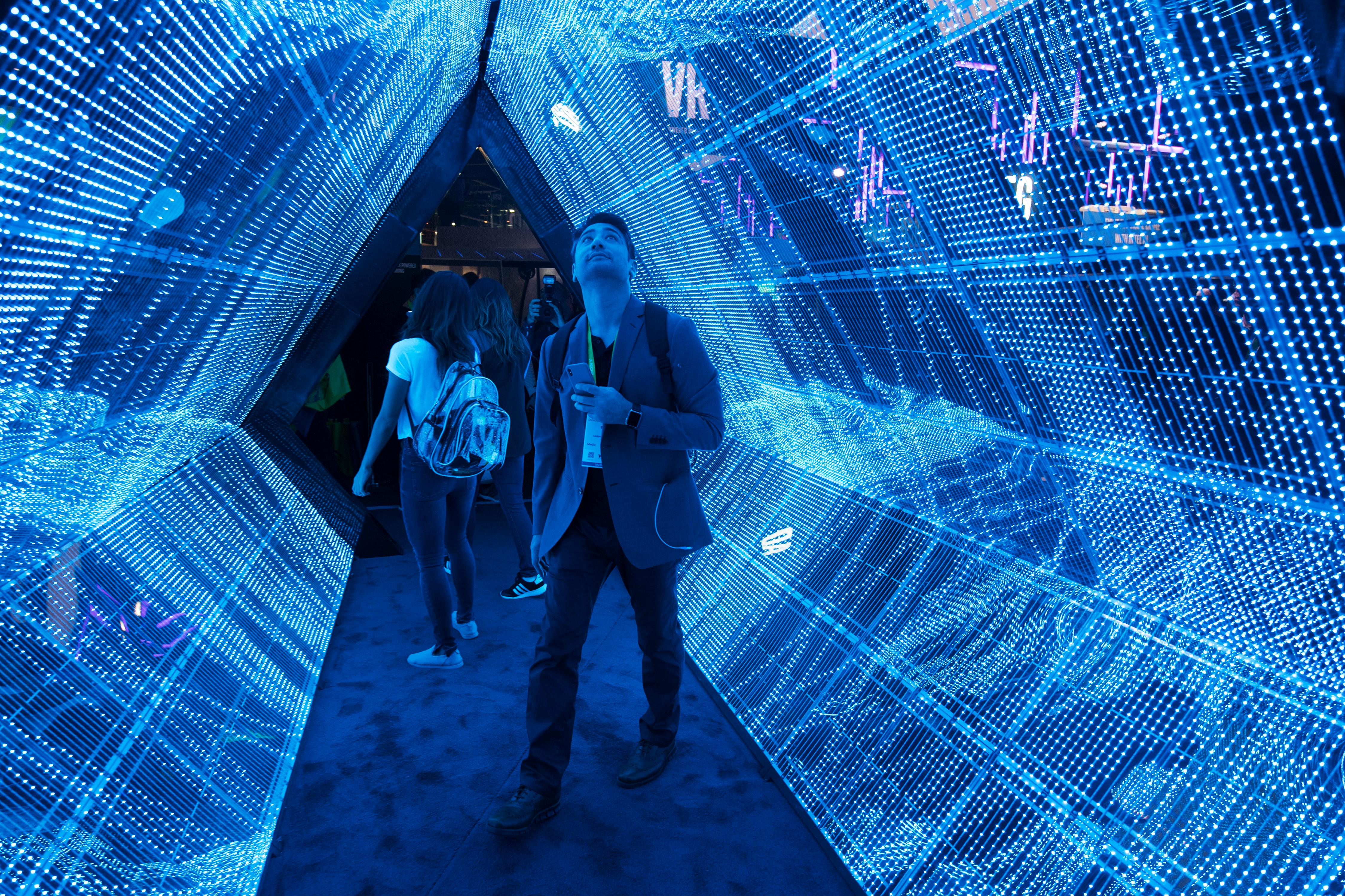 Todd Cox checks out a 5G tunnel from Intel during the second day of CES Wednesday, January 10, 2018, at the Las Vegas Convention Center. CREDIT: Sam Morris/Las Vegas News Bureau